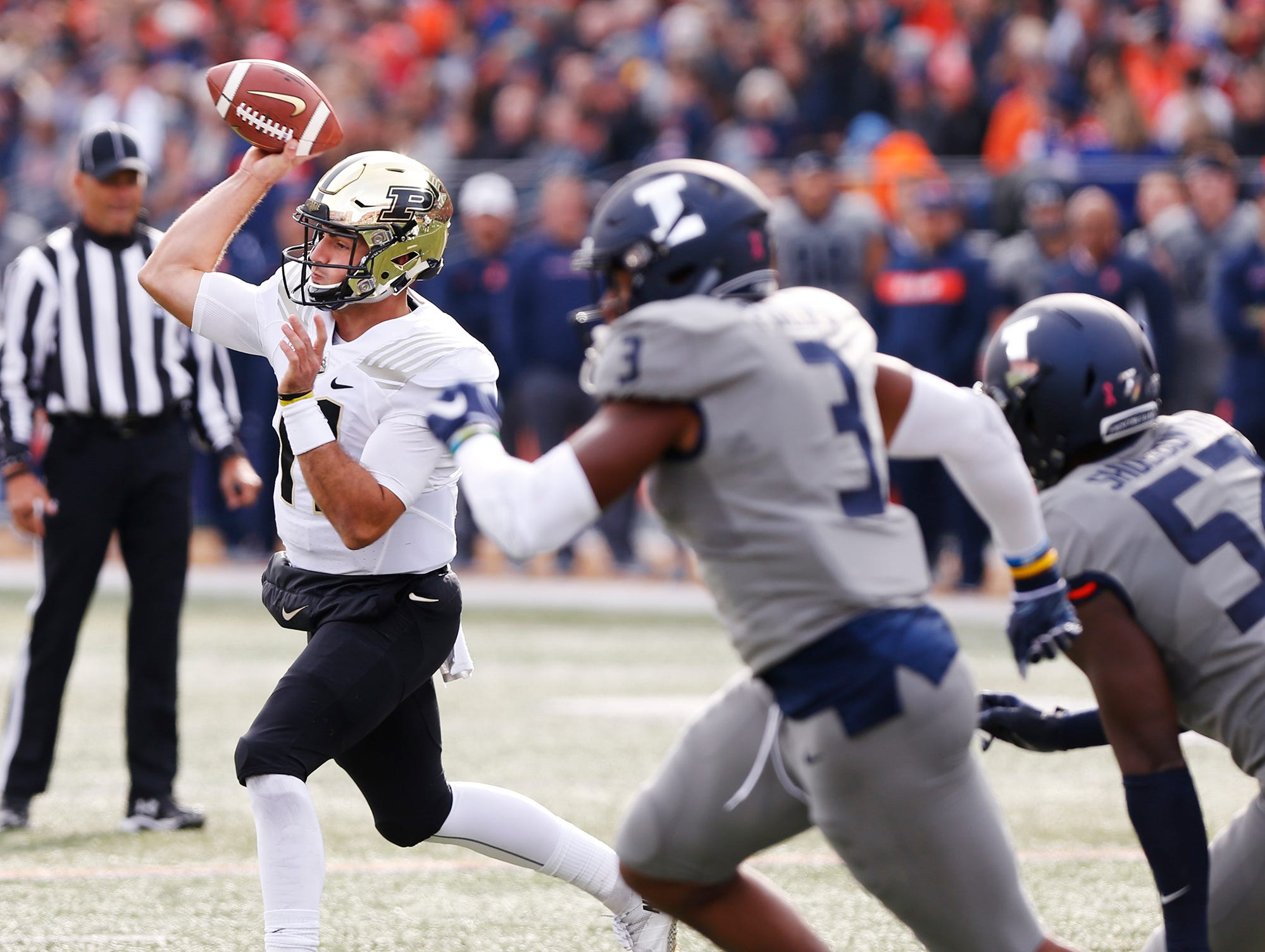 Purdue quarterback David Blough with a first half pass against Illinois Saturday, October 13, 2018, in Champaign, Illinois. Purdue thumped Illinois 46-7.