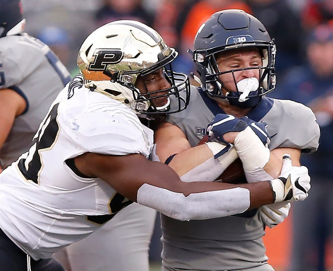 Purdue defensive end Kai Higgins brings down Mike Epstein of Illinois during the Boilermakers' 46-7 victory.