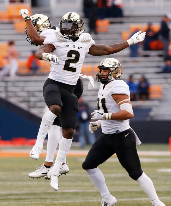 Kenneth Major of Purdue celebrates with teammates after he intercepted an Illinois pass with 9:43 remaining Saturday, October 13, 2018, in Champaign, Illinois. Purdue thumped Illinois 46-7.