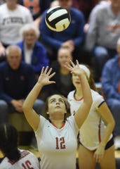 Raider senior Sami Isom focuses on setting the ball Saturday night in the Sectional final.