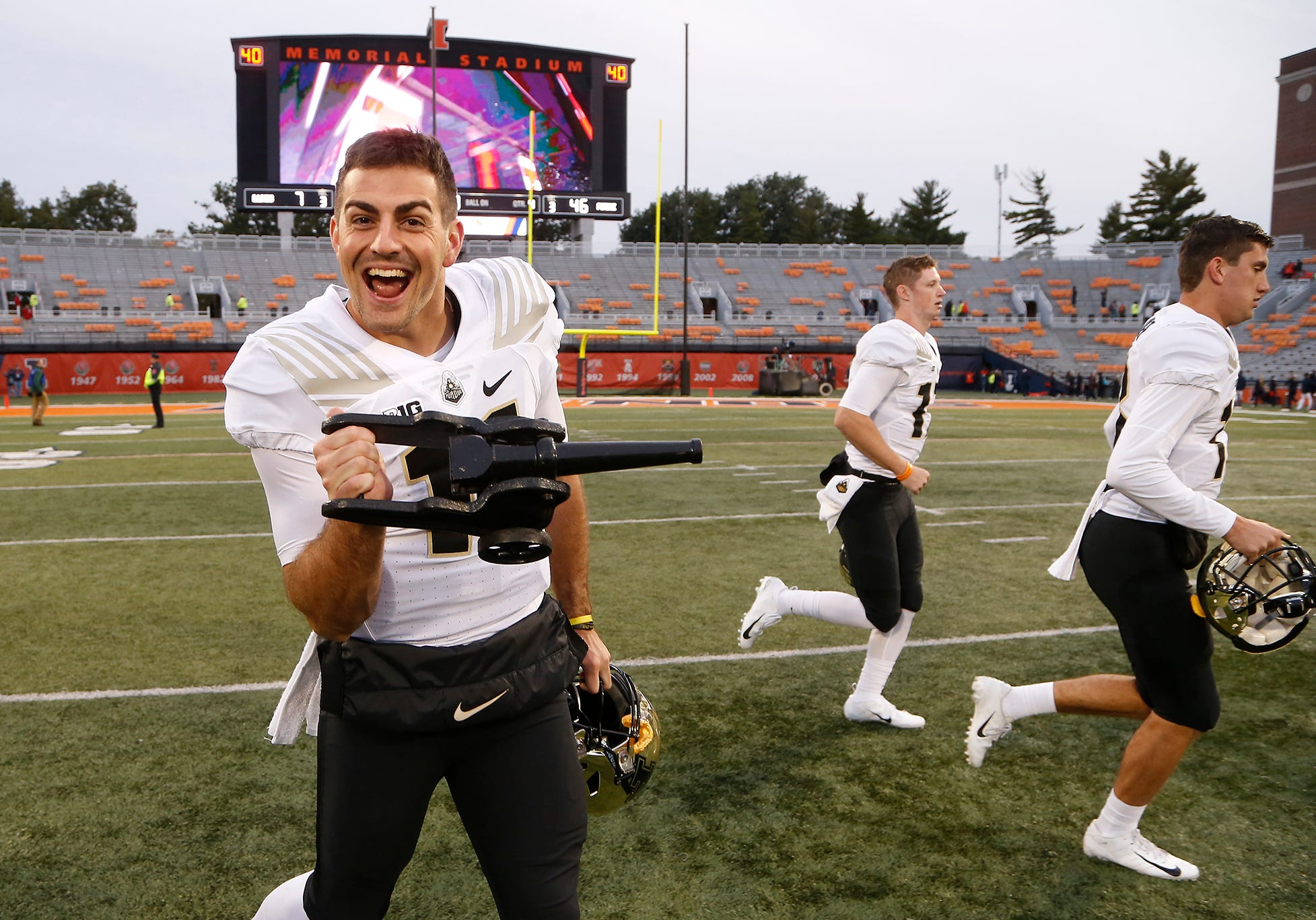 Purdue quarterback David Blough leaves the field with The Cannon traveling trophy after the Boilermakers pounded Illinois 46-7 Saturday, October 13, 2018, in Champaign, Illinois.