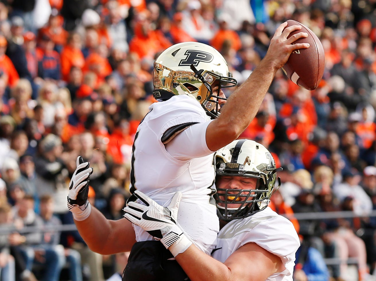 Matt McCann of Purdue lifts teammate David Blough into the air after Blough's touchdown reception at 4:06 in the first quarter against Illinois Saturday, October 13, 2018, in Champaign, Illinois. Purdue pounded Illinois 46-7.