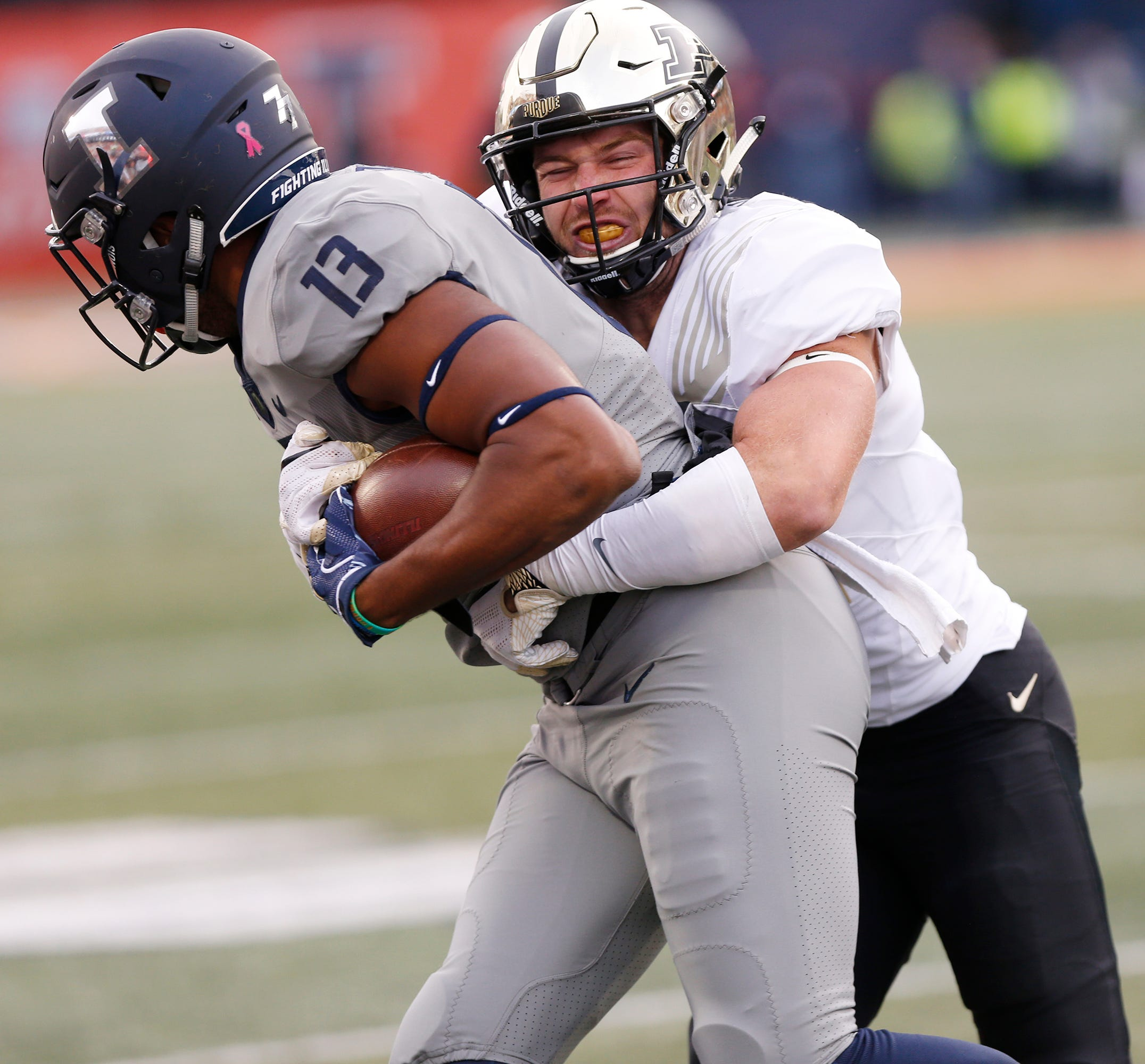 Jacob Thieneman of Purdue wraps up Caleb Reams of Illinois after a short pass reception in the second half Saturday, October 13, 2018, in Champaign, Illinois. Purdue thumped Illinois 46-7.