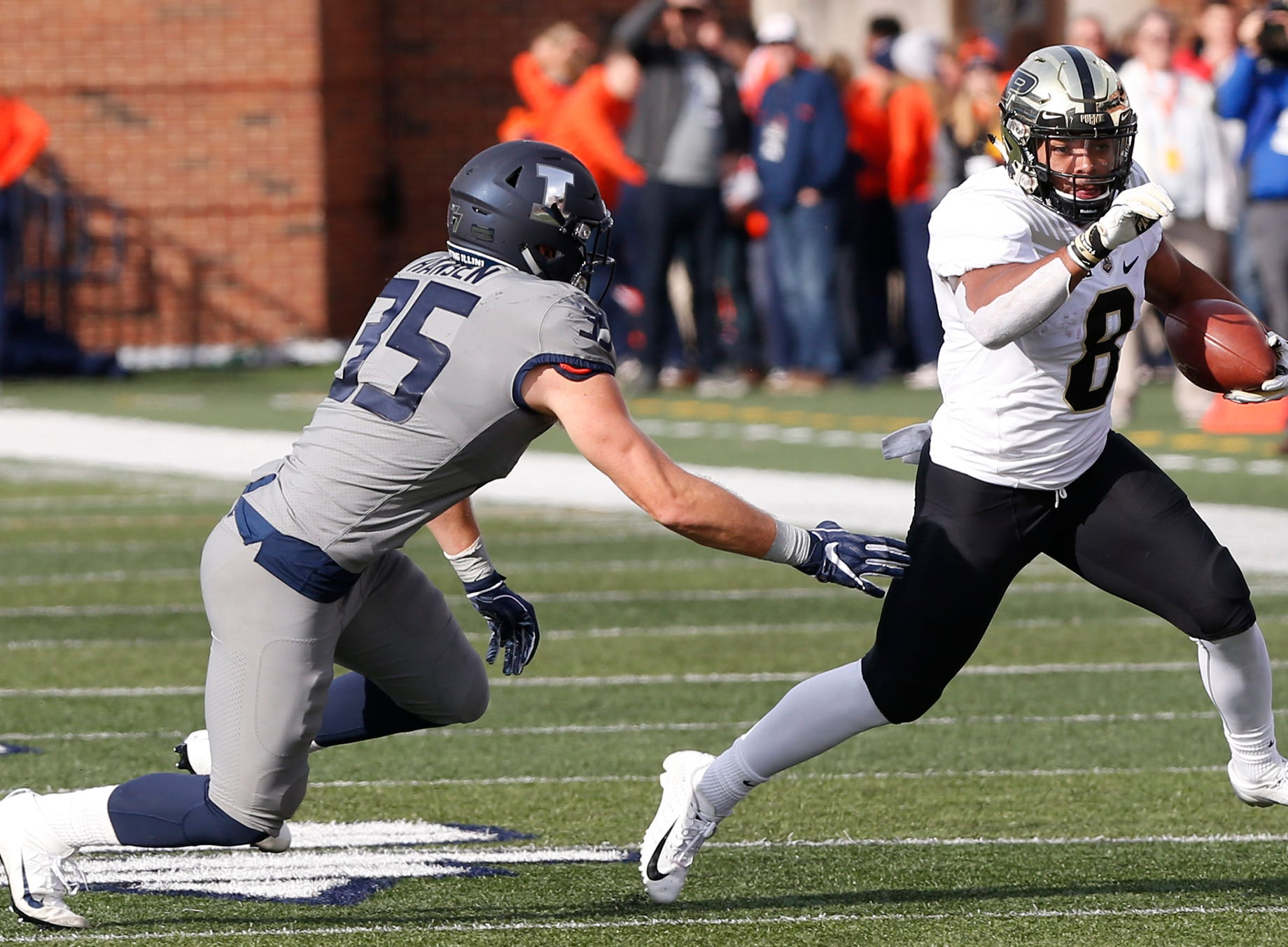Markell Jones of Purdue works to get around Jake Hansen of Illinois in the first half Saturday, October 13, 2018, in Champaign, Illinois. Purdue defeated Illinois 46-7.