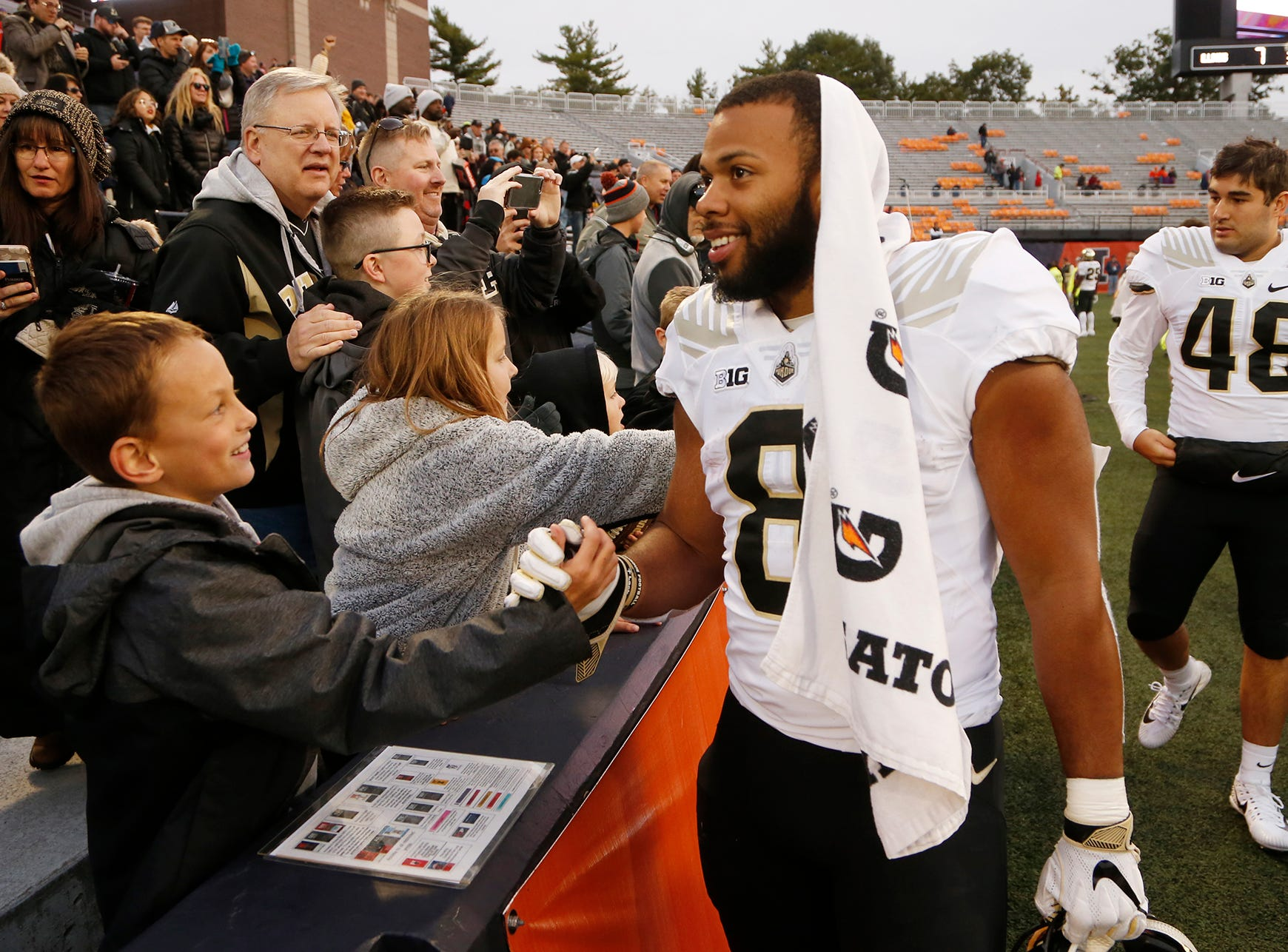 Markell Jones shakes hands with the Purdue faithful after the Boilermakers drubbed Illinois 46-7 Saturday, October 13, 2018, in Champaign, Illinois.