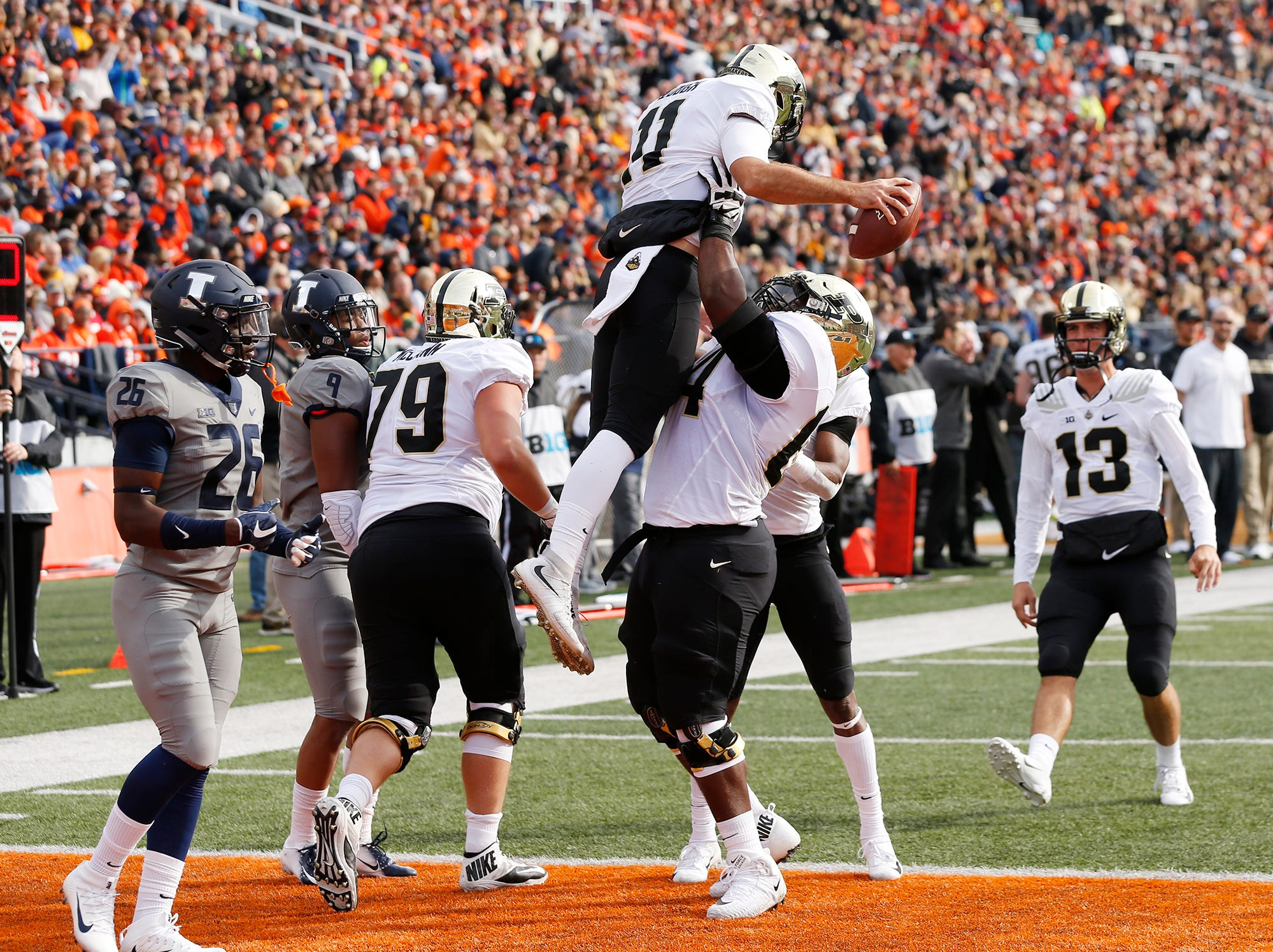 Dennis Edwards of Purdue lifts teammate David Blough into the air after Blough's touchdown reception at 4:06 in the first quarter against Illinois Saturday, October 13, 2018, in Champaign, Illinois. Purdue pounded Illinois 46-7.