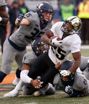 Tario Fuller of Purdue with a second half carry against Illinois Saturday, October 13, 2018, in Champaign, Illinois. Purdue thumped Illinois 46-7.