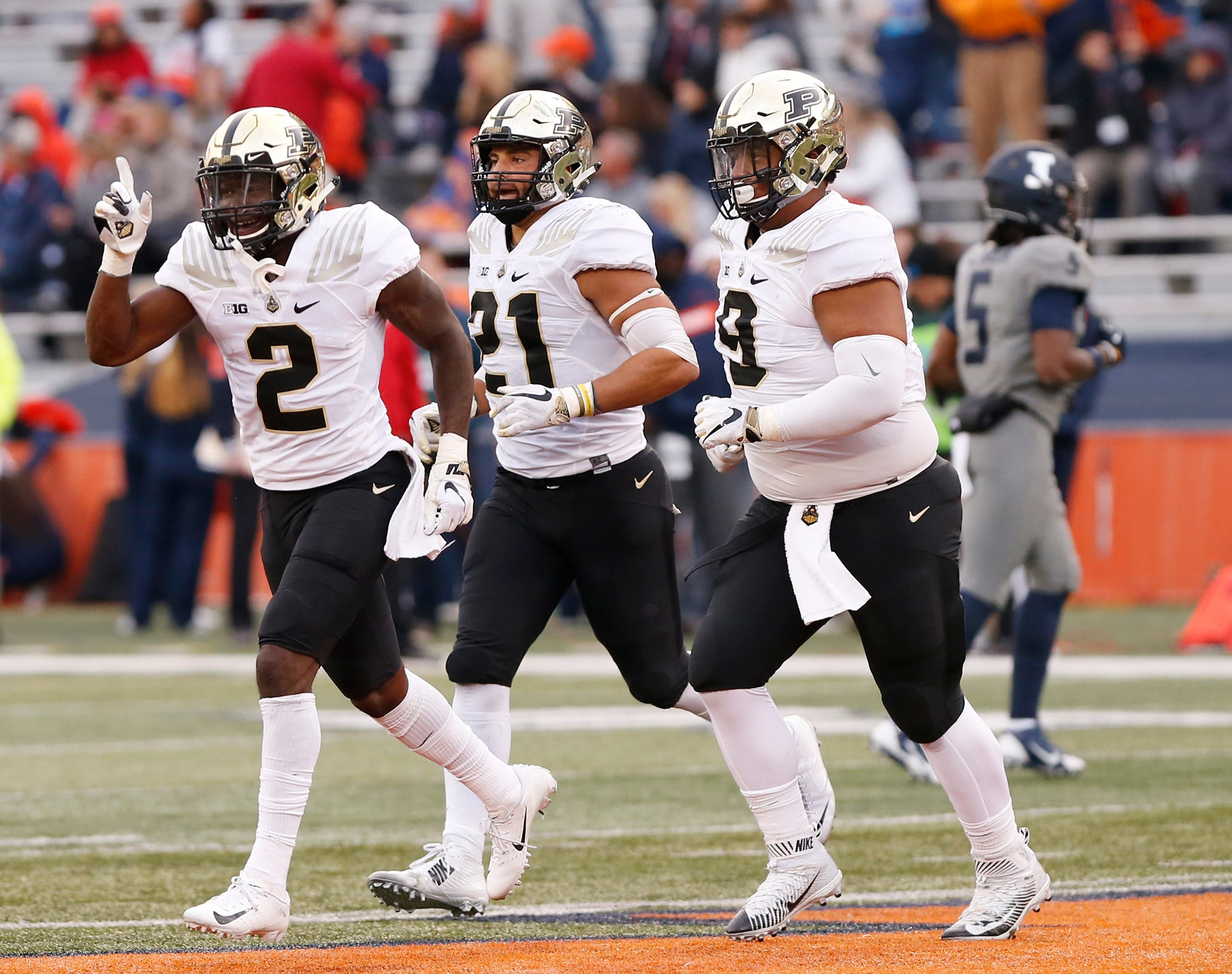 Kenneth Major of Purdue, left, reacts after he intercepted an Illinois pass with 9:43 remaining Saturday, October 13, 2018, in Champaign, Illinois. Purdue thumped Illinois 46-7.