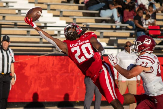 """UL's Jarrod """"Bam"""" Jackson makes a one-handed catch in the endzone to score a touchdown in the Ragin' Cajuns' homecoming game against New Mexico State on Oct. 13, 2018."""