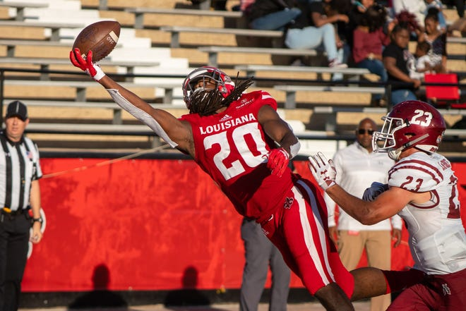 UL's Jarrod Bam Jackson makes a crazy catch for a touchdown in UL's 66-38 win over New Mexico State last Saturday night.
