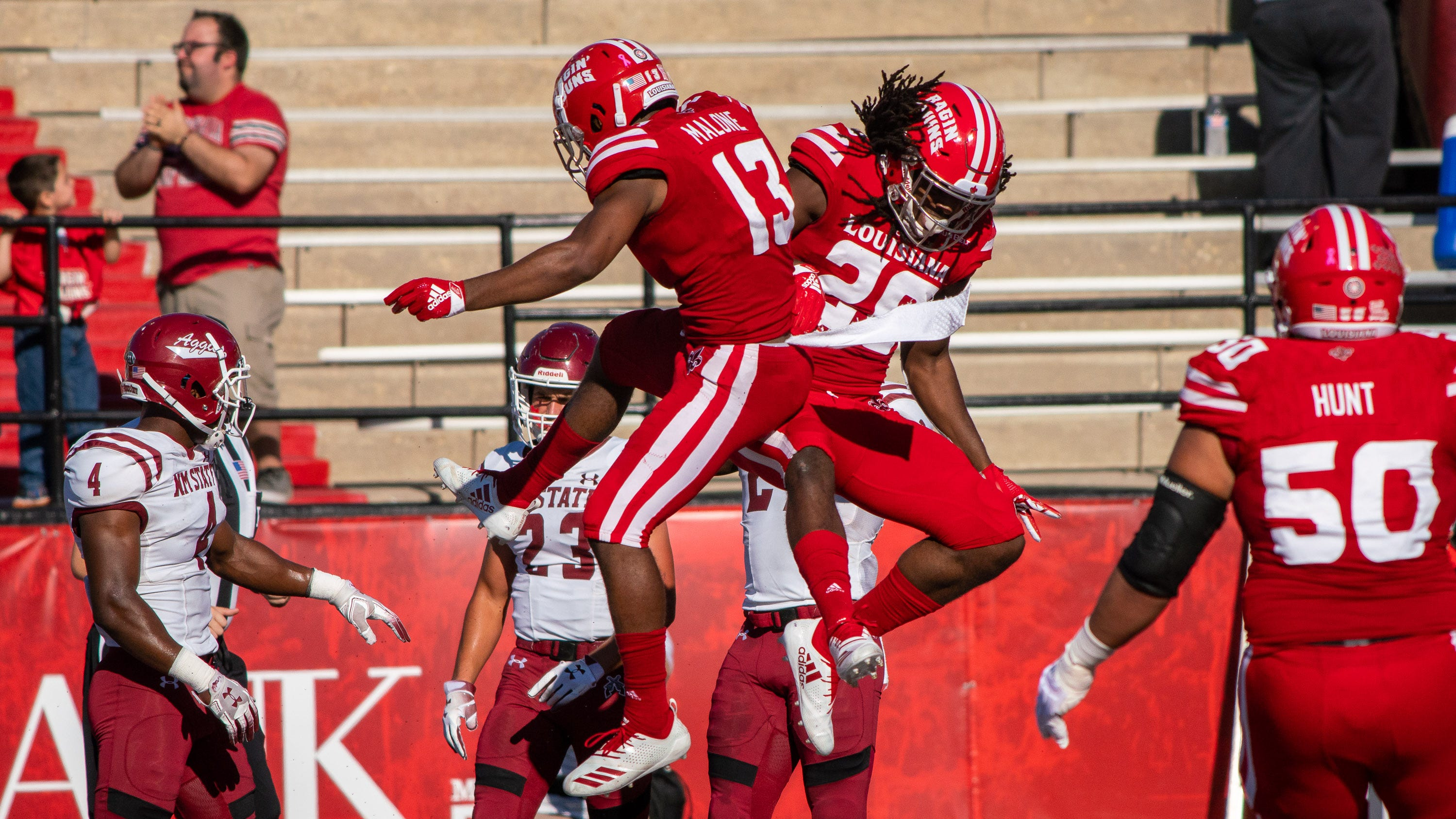 UL's Jarrod Jackson and Ryheem Malone celebrate after a touchdown as the Ragin' Cajuns play their Homecoming game against the New Mexico State Aggies at Cajun Field on Oct. 13, 2018.