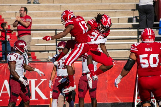 UL's Jarrod Jackson and Ryheem Malone (13) celebrate after a touchdown during Saturday's 66-38 Homecoming win over New Mexico State.