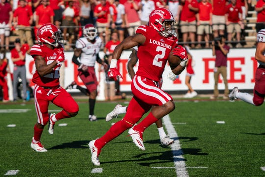 UL's Ja'Marcus Bradley runs the ball down the field as the Ragin' Cajuns play their Homecoming game against the New Mexico State Aggies at Cajun Field on Oct. 13, 2018.