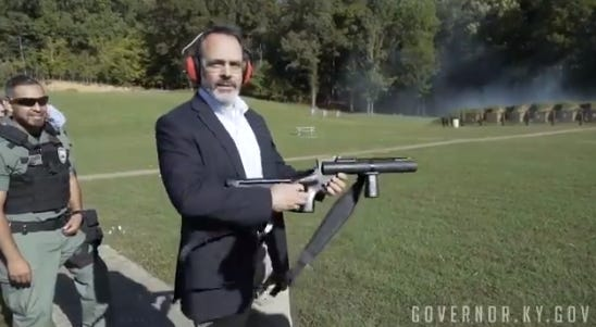 Gov. Matt Bevin holds a grenade launcher at the gun range at the state penitentiary in Eddyville.