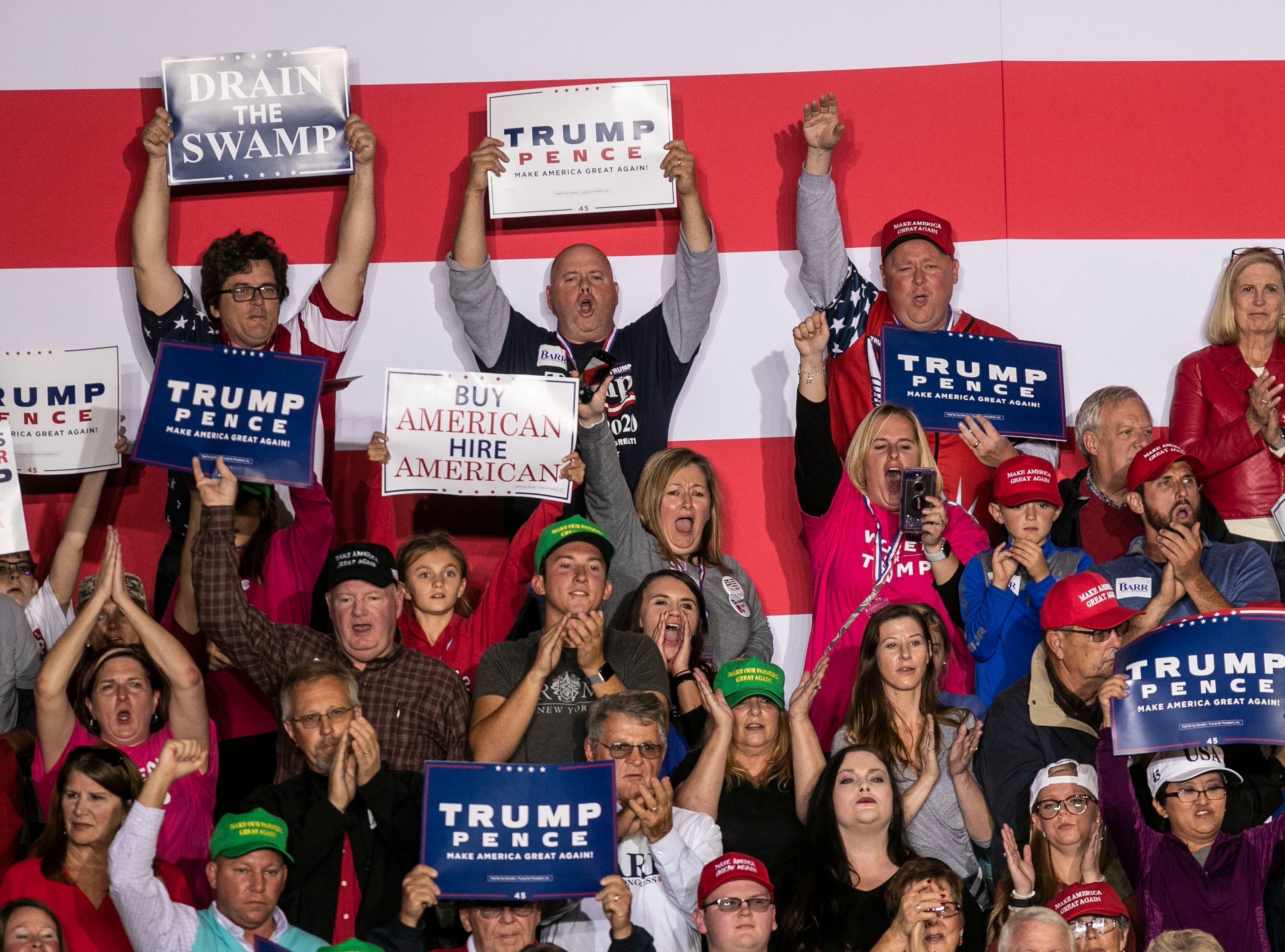 The crowd cheers during President Donald Trump's speech on the Eastern Kentucky University campus Saturday night.