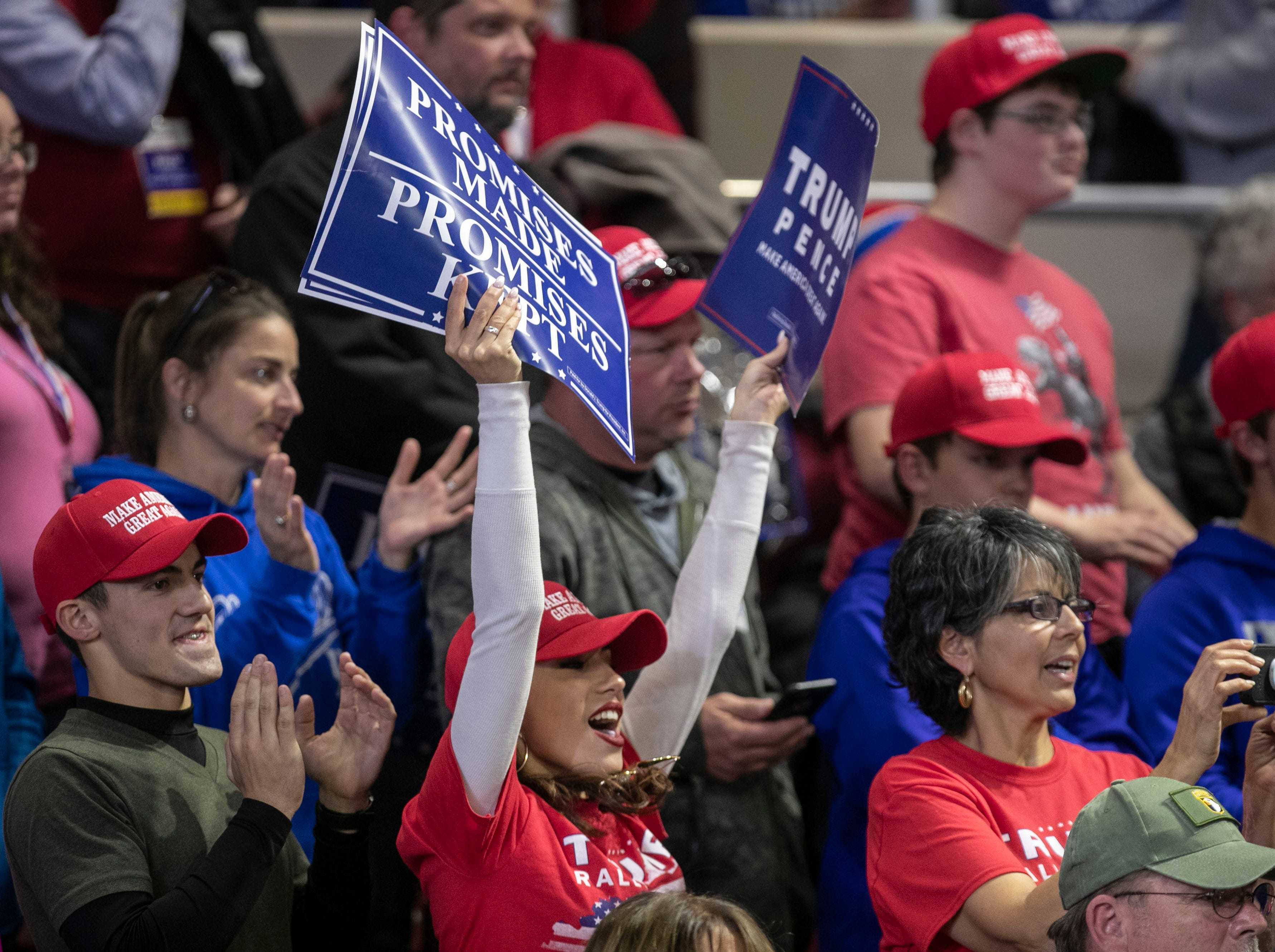 Most of the  crowd stood on their feet as President Donald Trump gave a speech during on the Eastern Kentucky University campus Saturday night.
