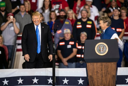 President Donald Trump shared the stage with Senator Rand Paul during a rally on the Eastern Kentucky University campus  in 2018.