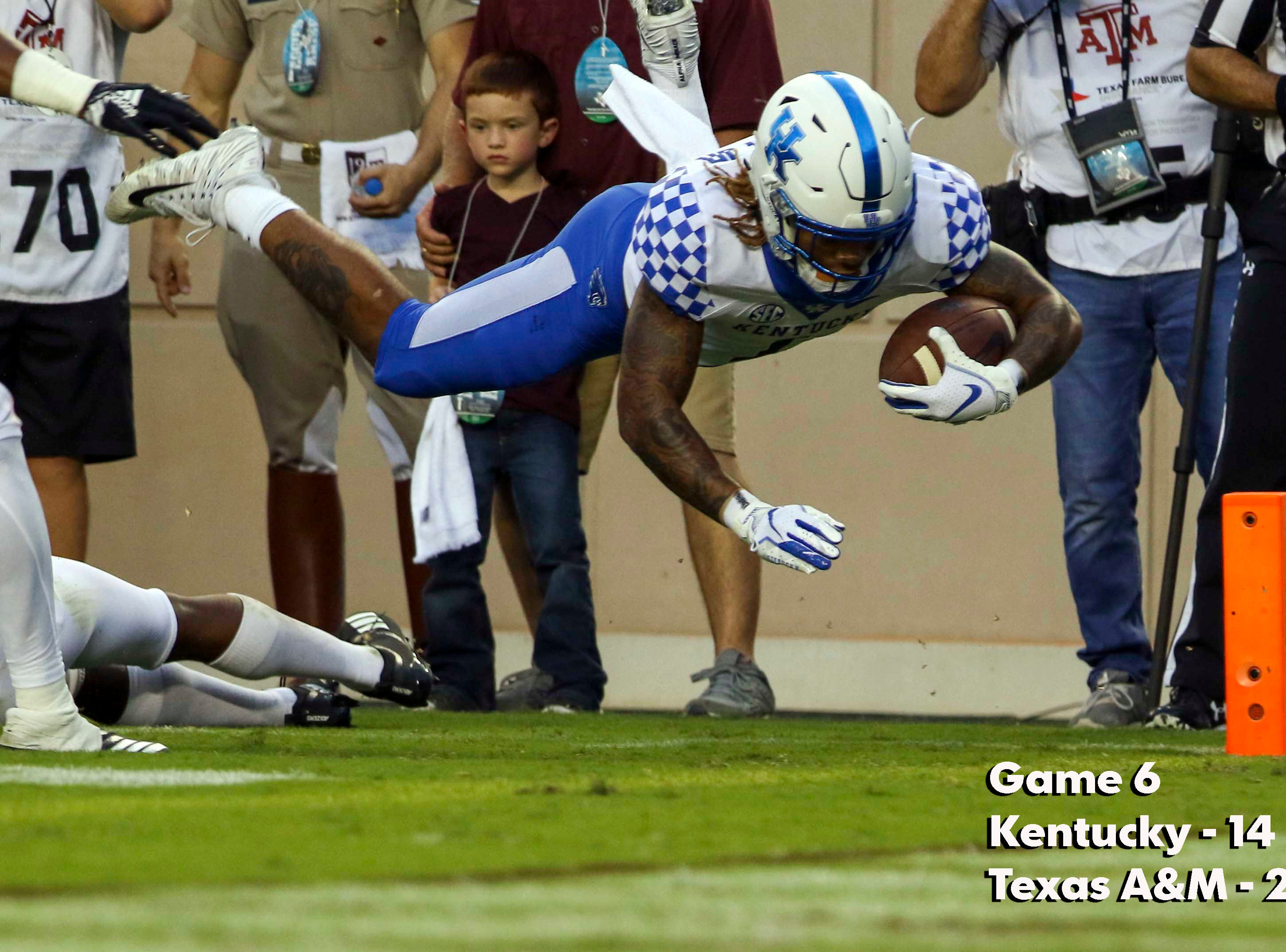 Oct 6, 2018; College Station, TX, USA; Kentucky Wildcats wide receiver Lynn Bowden Jr. (1) dives into the end zone for a touchdown during the first quarter against the Texas A&M Aggies at Kyle Field. Mandatory Credit: John Glaser-USA TODAY Sports