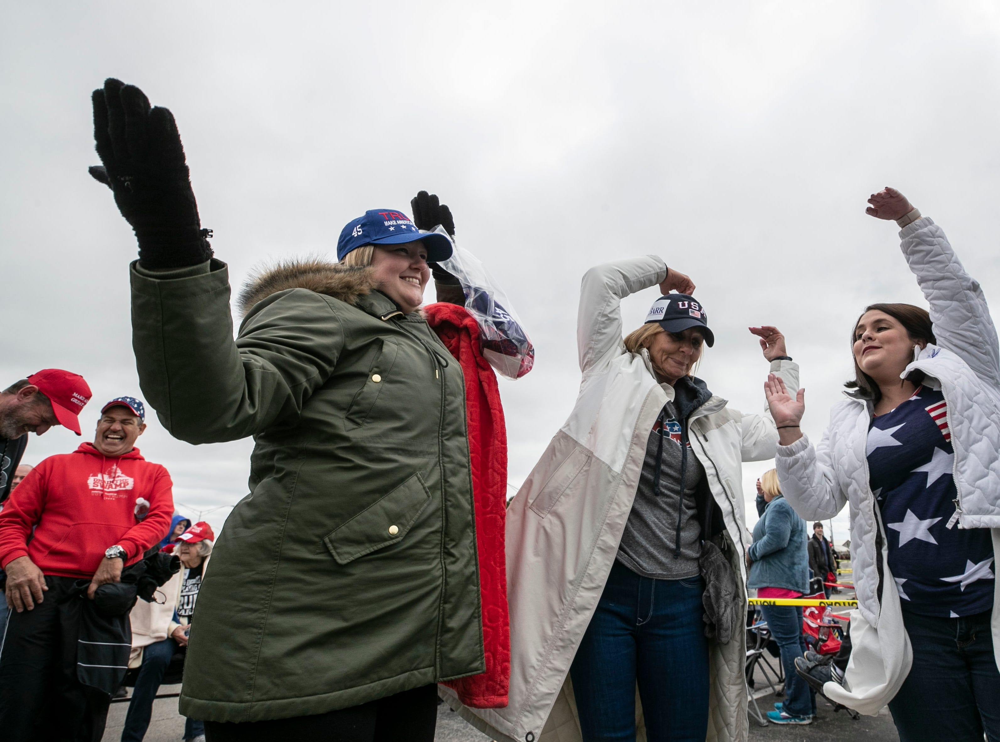 The crowd waiting for President Donald Trump danced as 1970s group The Village People's 'YMCA' played on loudspeakers in a parking lot outside the Alumni Coliseum in Richmond, Ky.