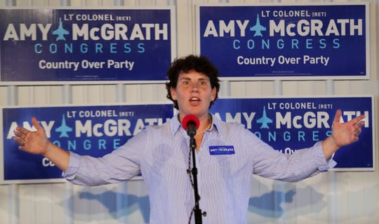 Congressional candidate Amy McGrath speaks at a potluck rally in Frankfort, Ky. 