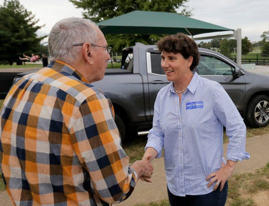 Congressional candidate Amy McGrath meets voters at a potluck rally in Frankfort, Ky. 