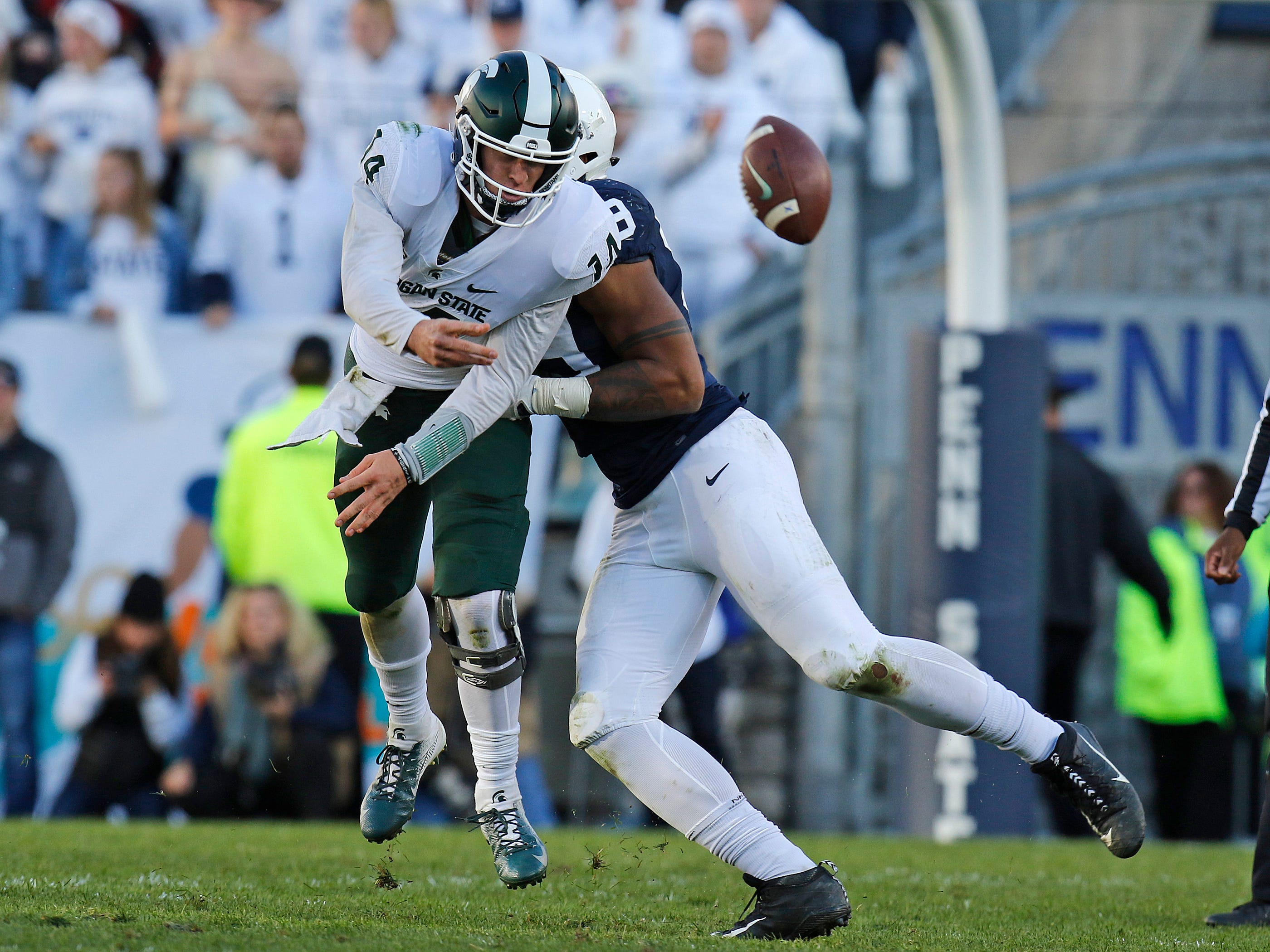 Yetur Gross-Matos #99 of the Penn State Nittany Lions hurries Brian Lewerke #14 of the Michigan State Spartans on October 13, 2018 at Beaver Stadium in State College, Pennsylvania.
