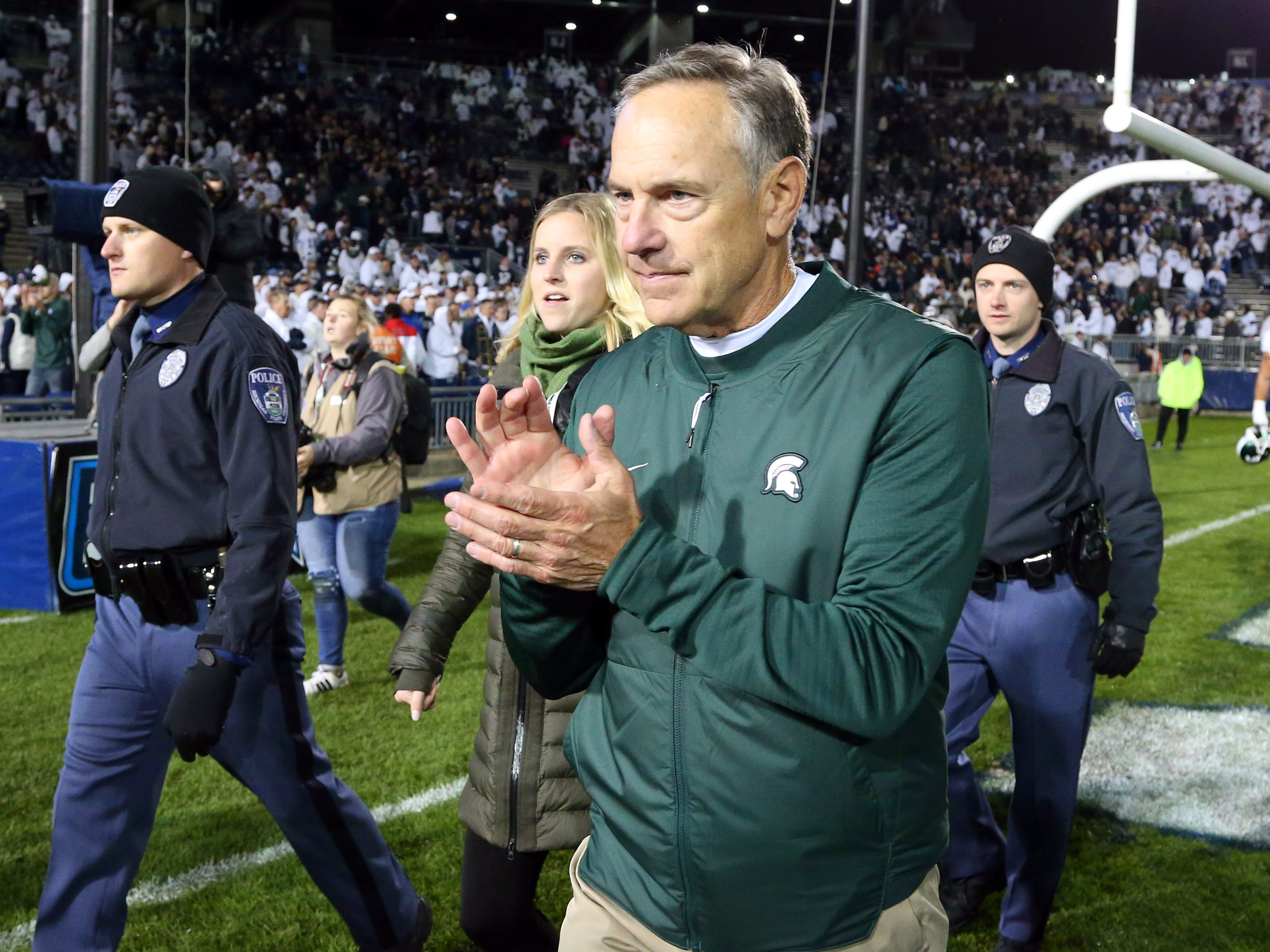 Michigan State Spartans head coach Mark Dantonio reacts while walking of the field following the game against the Penn State Nittany Lions at Beaver Stadium.