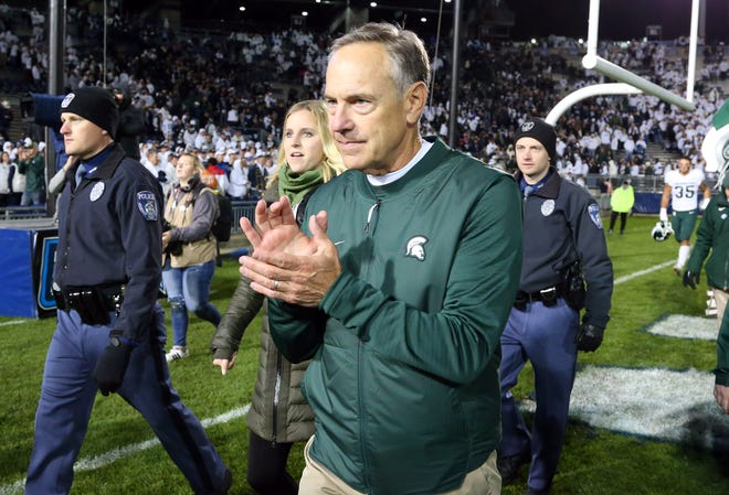 Michigan State football coach Mark Dantonio reacts while walking off the field after this year's win at Penn State. MSU is 53-23 in Big Ten games since 2010.