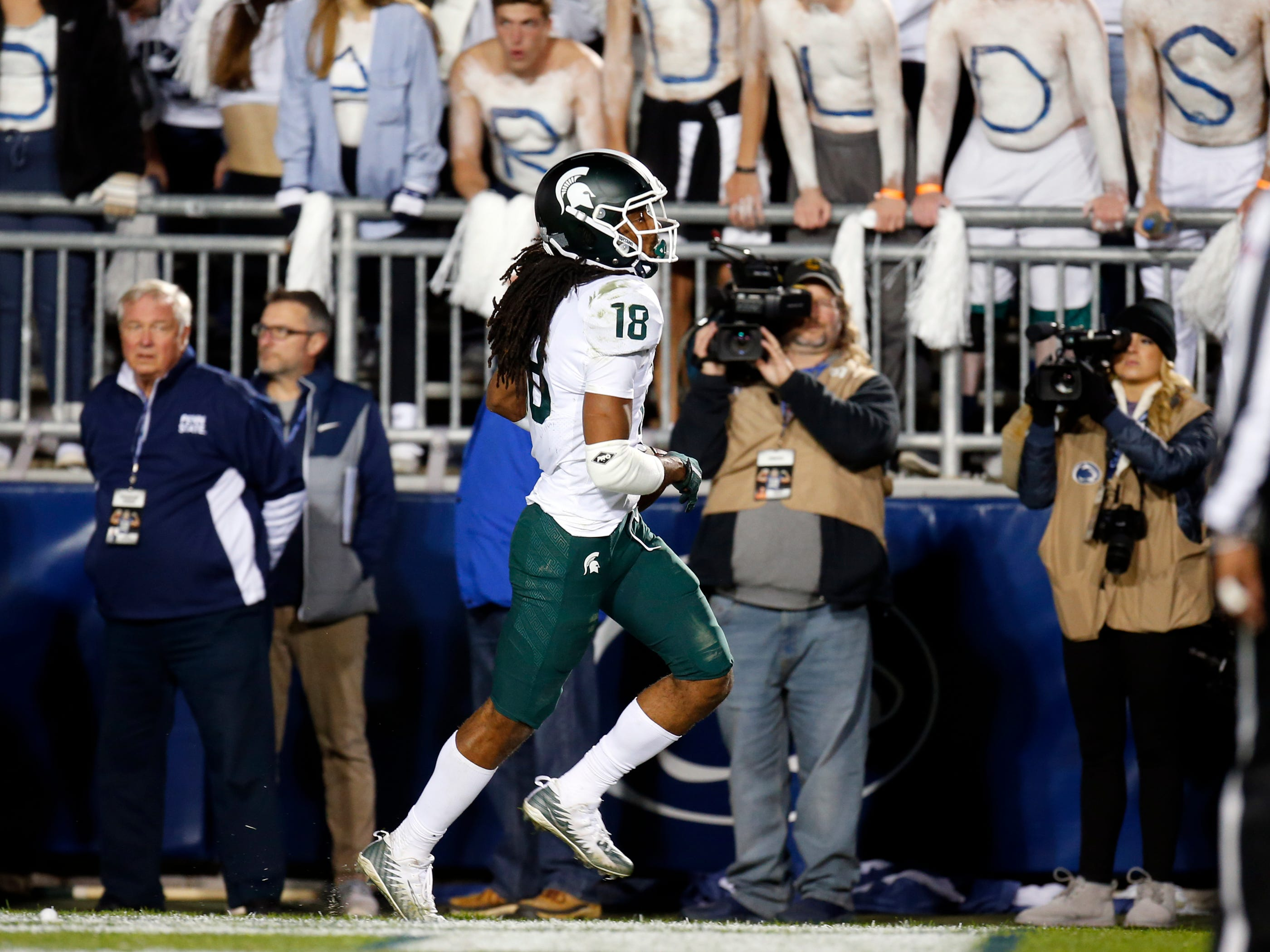 Felton Davis III #18 of the Michigan State Spartans celebrates after catching a 25 yard touchdown pass in the fourth quarter against Amani Oruwariye #21 of the Penn State Nittany Lions on October 13, 2018 at Beaver Stadium in State College, Pennsylvania.