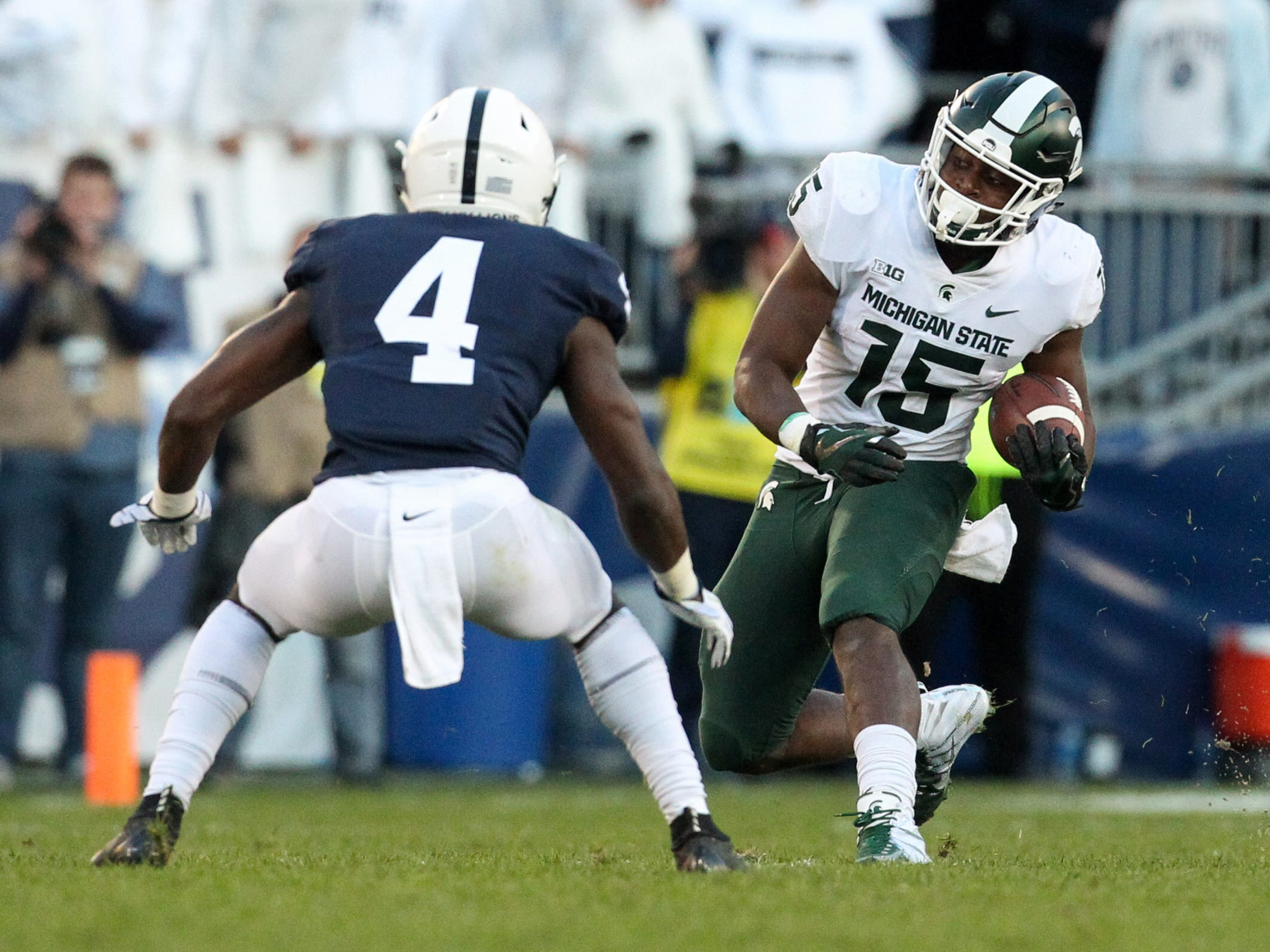 Michigan State Spartans running back La'Darius Jefferson (15) runs with the ball as Penn State Nittany Lions safety Nick Scott (4) defends during the third quarter at Beaver Stadium. Michigan State defeated Penn State 21-17.