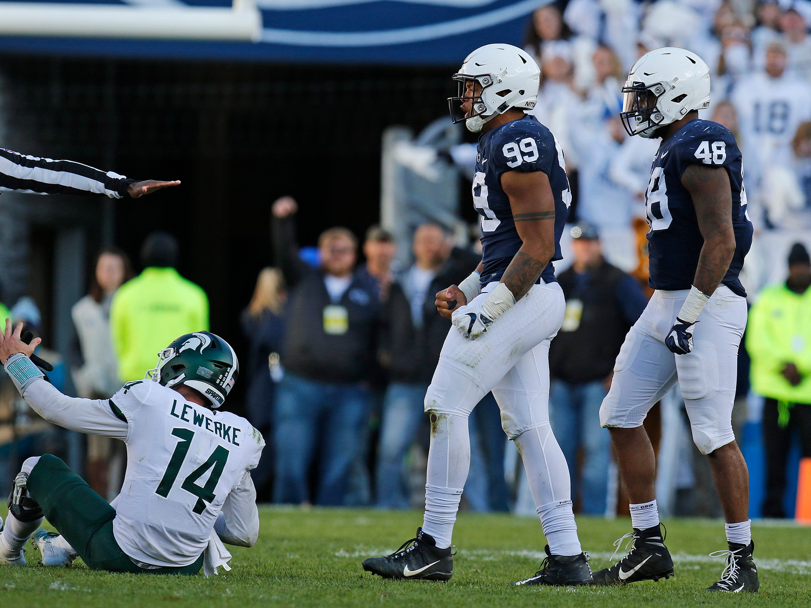 Yetur Gross-Matos #99 of the Penn State Nittany Lions celebrates against Brian Lewerke #14 of the Michigan State Spartans on October 13, 2018 at Beaver Stadium in State College, Pennsylvania.