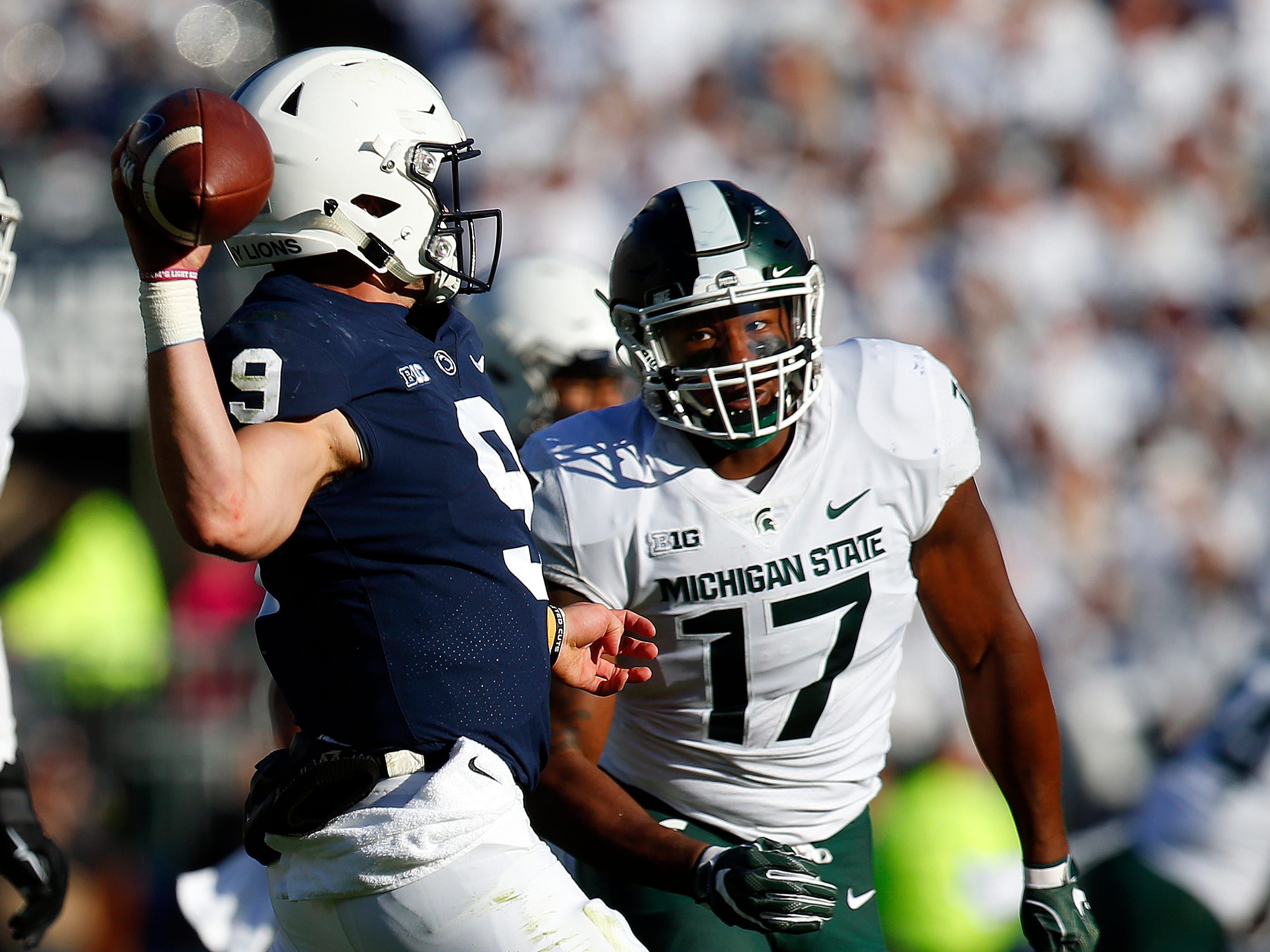 Trace McSorley #9 of the Penn State Nittany Lions is pressured by Tyriq Thompson #17 of the Michigan State Spartans on October 13, 2018 at Beaver Stadium in State College, Pennsylvania.