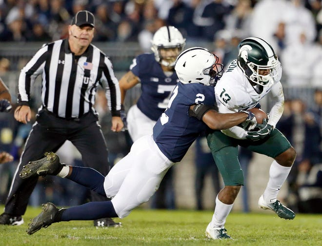 Penn State's Donovan Johnson (2) tackles Michigan State's Laress Nelson (13) after a catch during the second half of an NCAA college football game in State College, Pa., Saturday, Oct. 13, 2018.