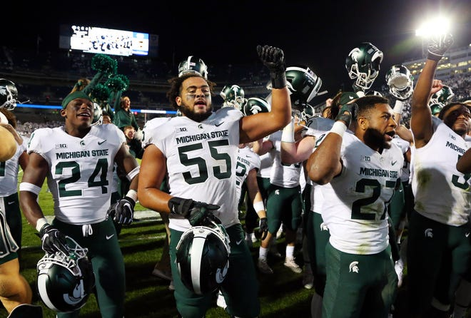Michigan State Spartans players celebrate following the game against the Penn State Nittany Lions at Beaver Stadium.