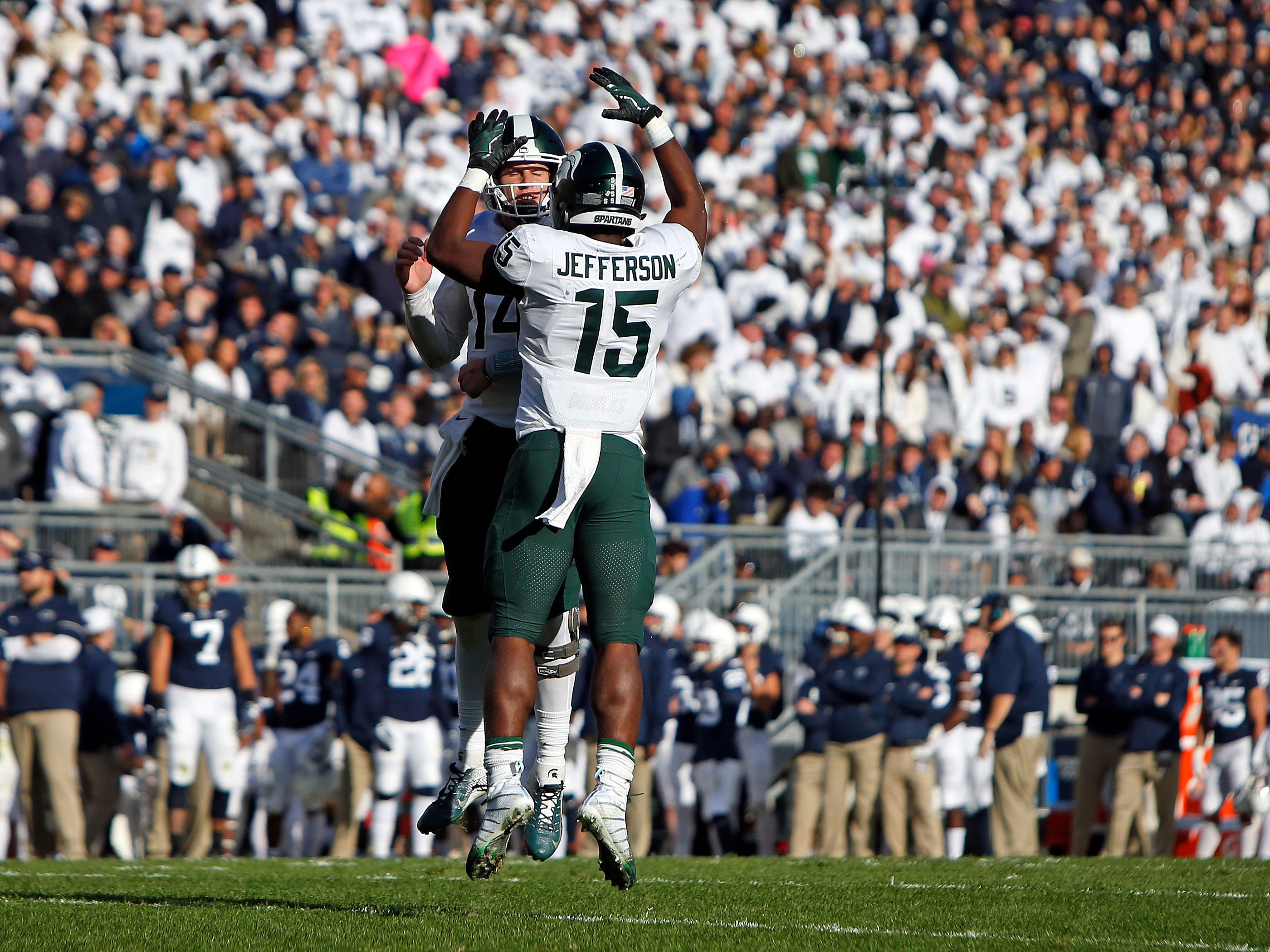 La'Darius Jefferson #15 of the Michigan State Spartans celebrates with Brian Lewerke #14 after scoring a 1 yard touchdown in the first half against the Penn State Nittany Lions on October 13, 2018 at Beaver Stadium in State College, Pennsylvania.
