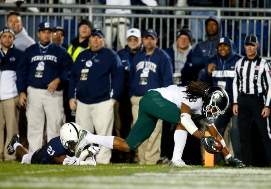 Felton Davis III #18 of the Michigan State Spartans catches a 25 yard touchdown pass in the fourth quarter against Amani Oruwariye #21 of the Penn State Nittany Lions on October 13, 2018 at Beaver Stadium in State College, Pennsylvania.