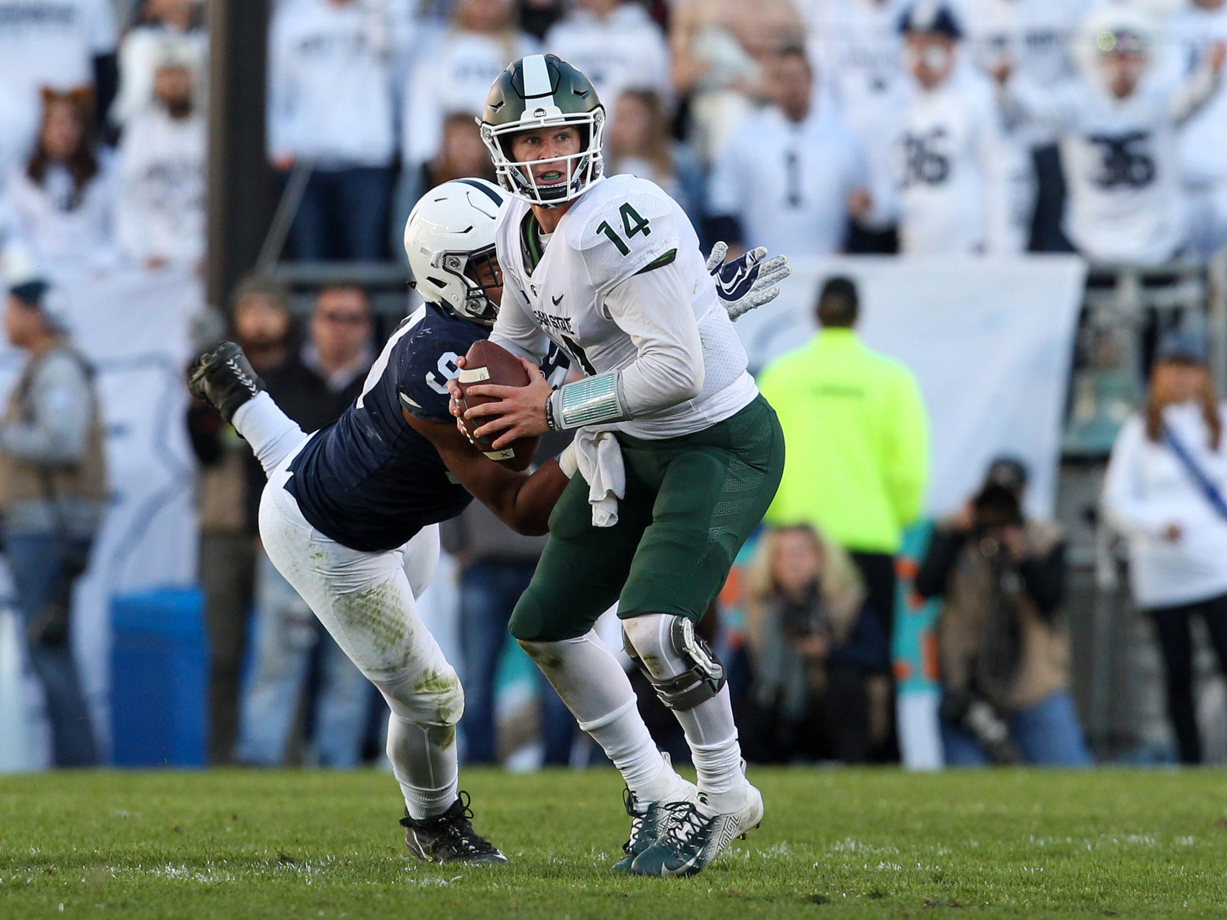 Penn State Nittany Lions defensive end Yetur Gross-Matos (99) sacks Michigan State Spartans Michigan State Spartans quarterback Brian Lewerke (14) during the second quarter at Beaver Stadium.