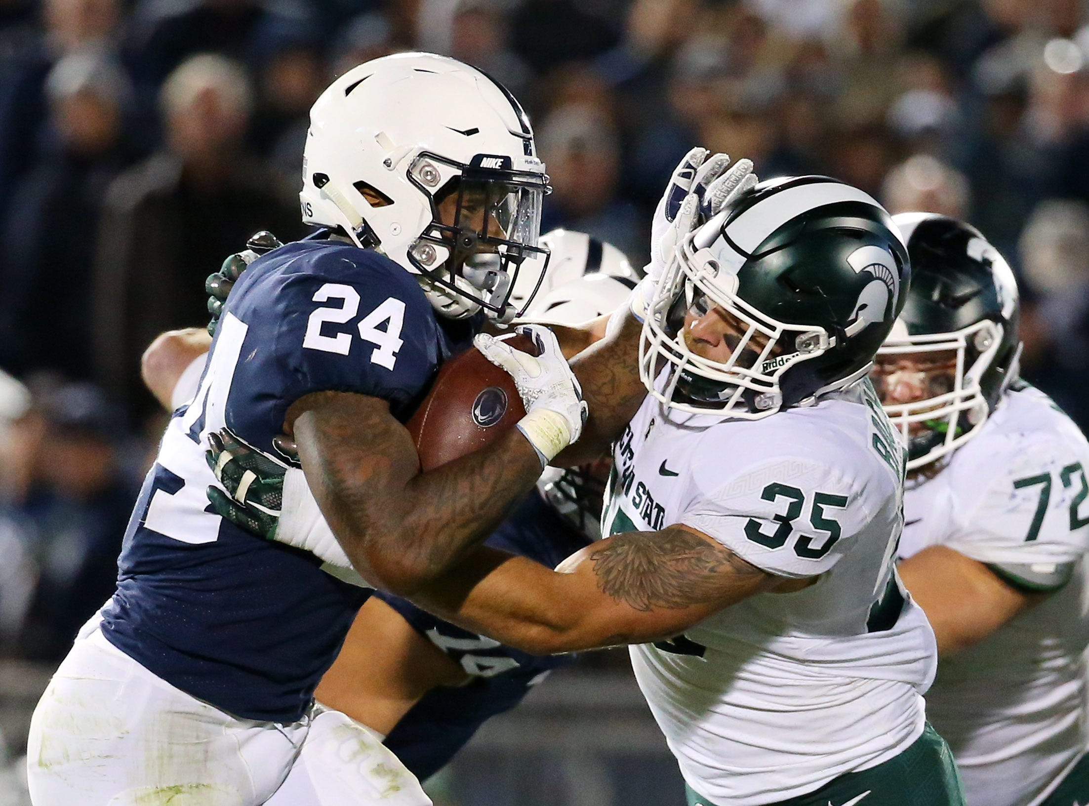 Oct 13, 2018; University Park, PA, USA; Michigan State Spartans linebacker Joe Bachie (35) tackles Penn State Nittany Lions running back Miles Sanders (24) during the fourth quarter at Beaver Stadium. Mandatory Credit: Rich Barnes-USA TODAY Sports