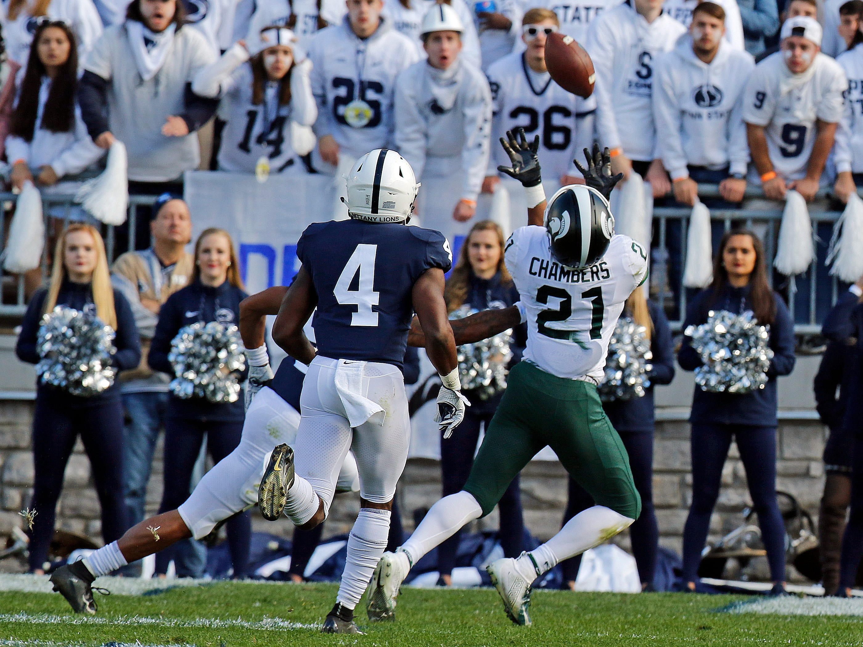 Cam Chambers #21 of the Michigan State Spartans pulls in a catch against Nick Scott #4 of the Penn State Nittany Lions on October 13, 2018 at Beaver Stadium in State College, Pennsylvania.