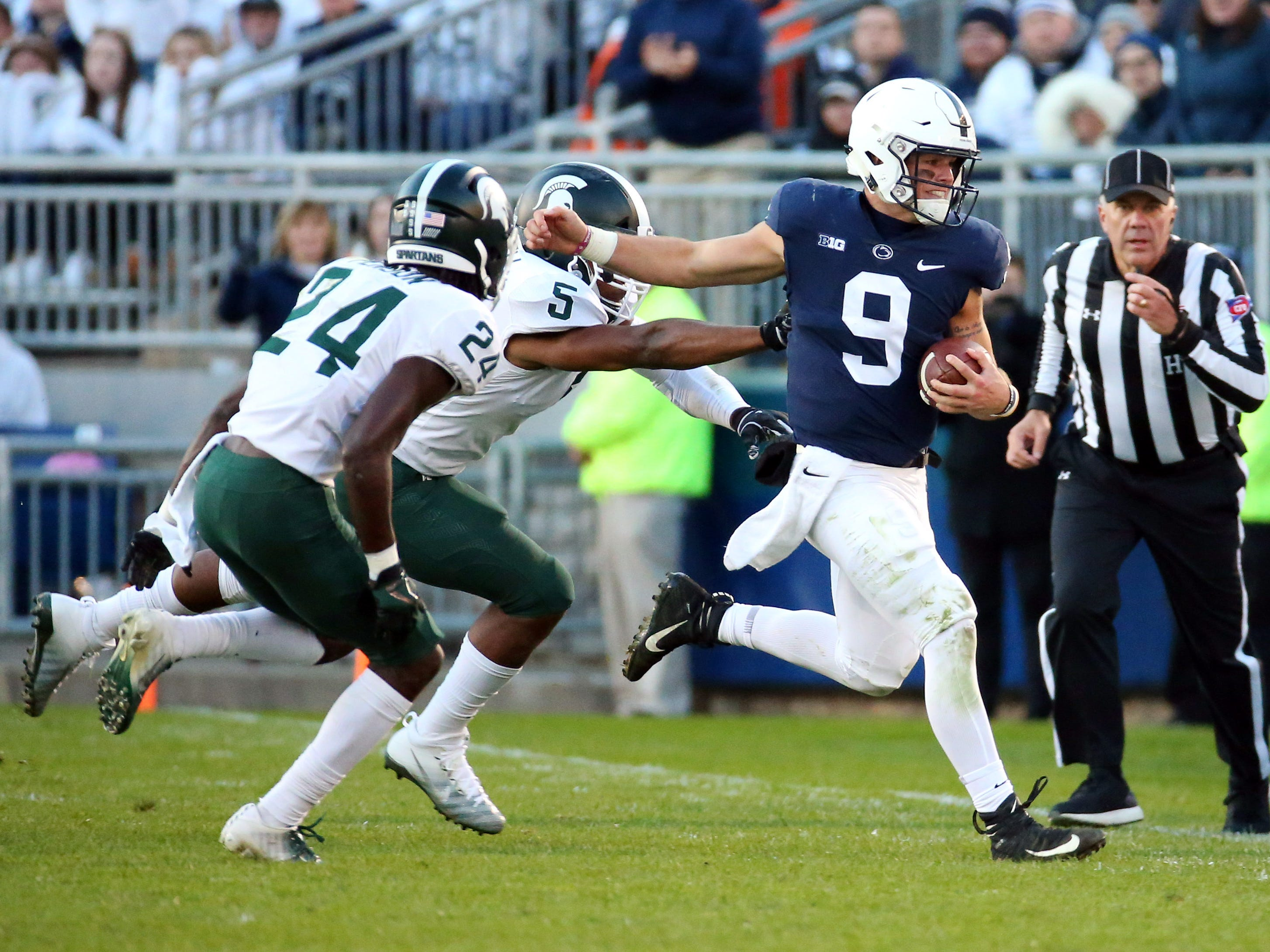 Penn State Nittany Lions quarterback Trace McSorley (9) runs with the ball past Michigan State Spartans safety Tre Person (24) and linebacker Andrew Dowell (5) during the third quarter at Beaver Stadium.