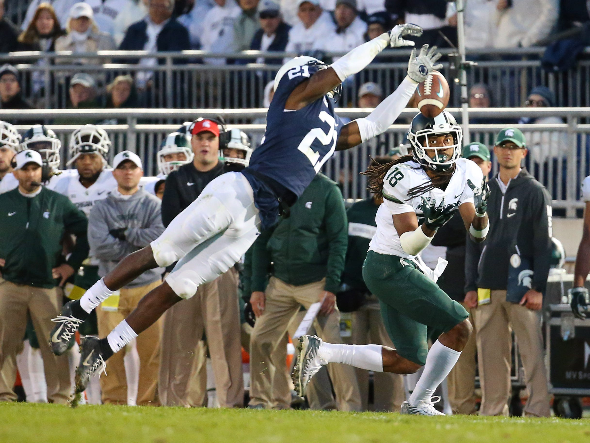 Michigan State Spartans wide receiver Felton Davis III (18) catches a pass against Penn State Nittany Lions cornerback Amani Oruwariye (21) during the fourth quarter at Beaver Stadium.