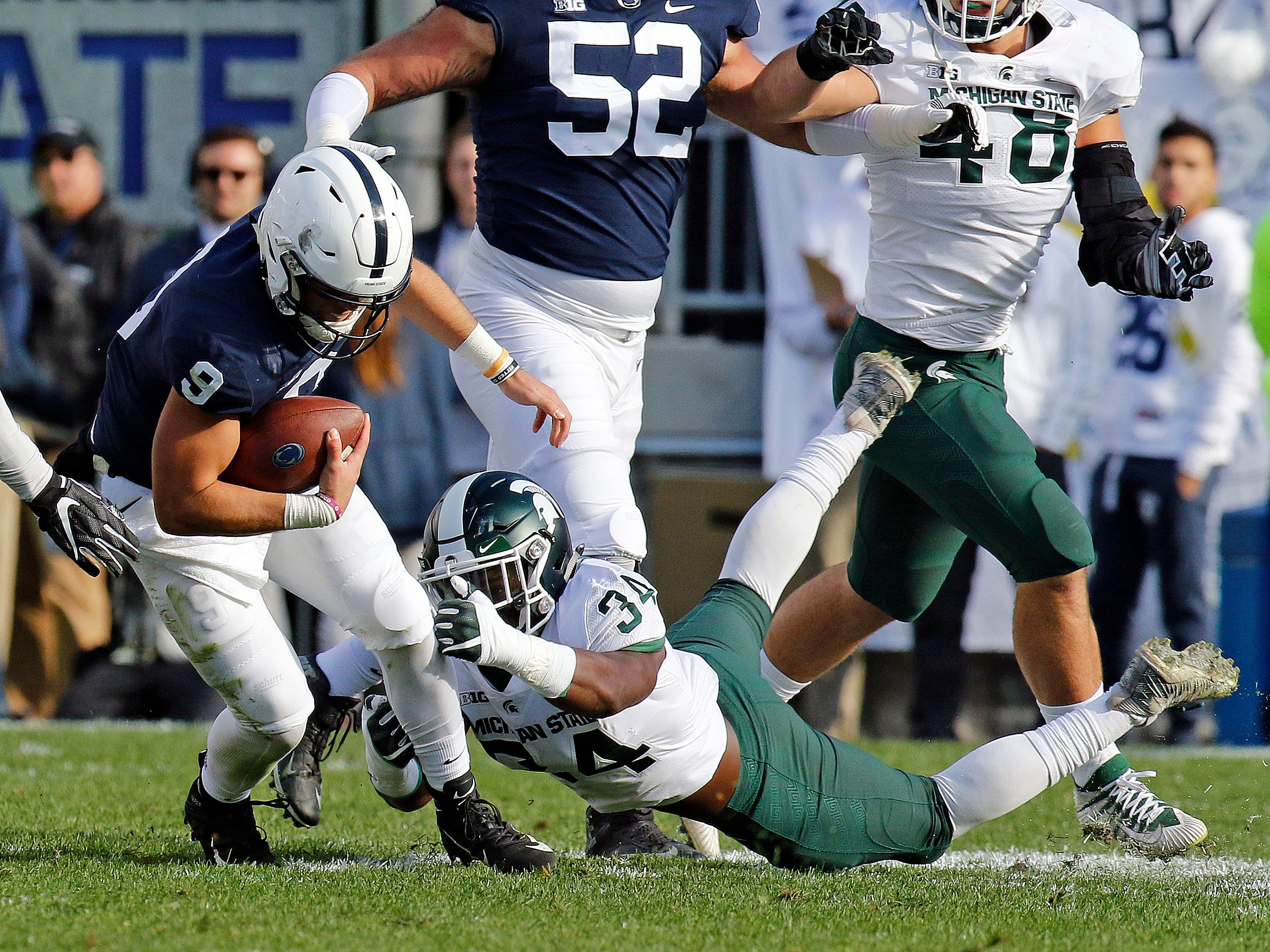 Antjuan Simmons #34 of the Michigan State Spartans tackles Trace McSorley #9 of the Penn State Nittany Lions on October 13, 2018 at Beaver Stadium in State College, Pennsylvania.