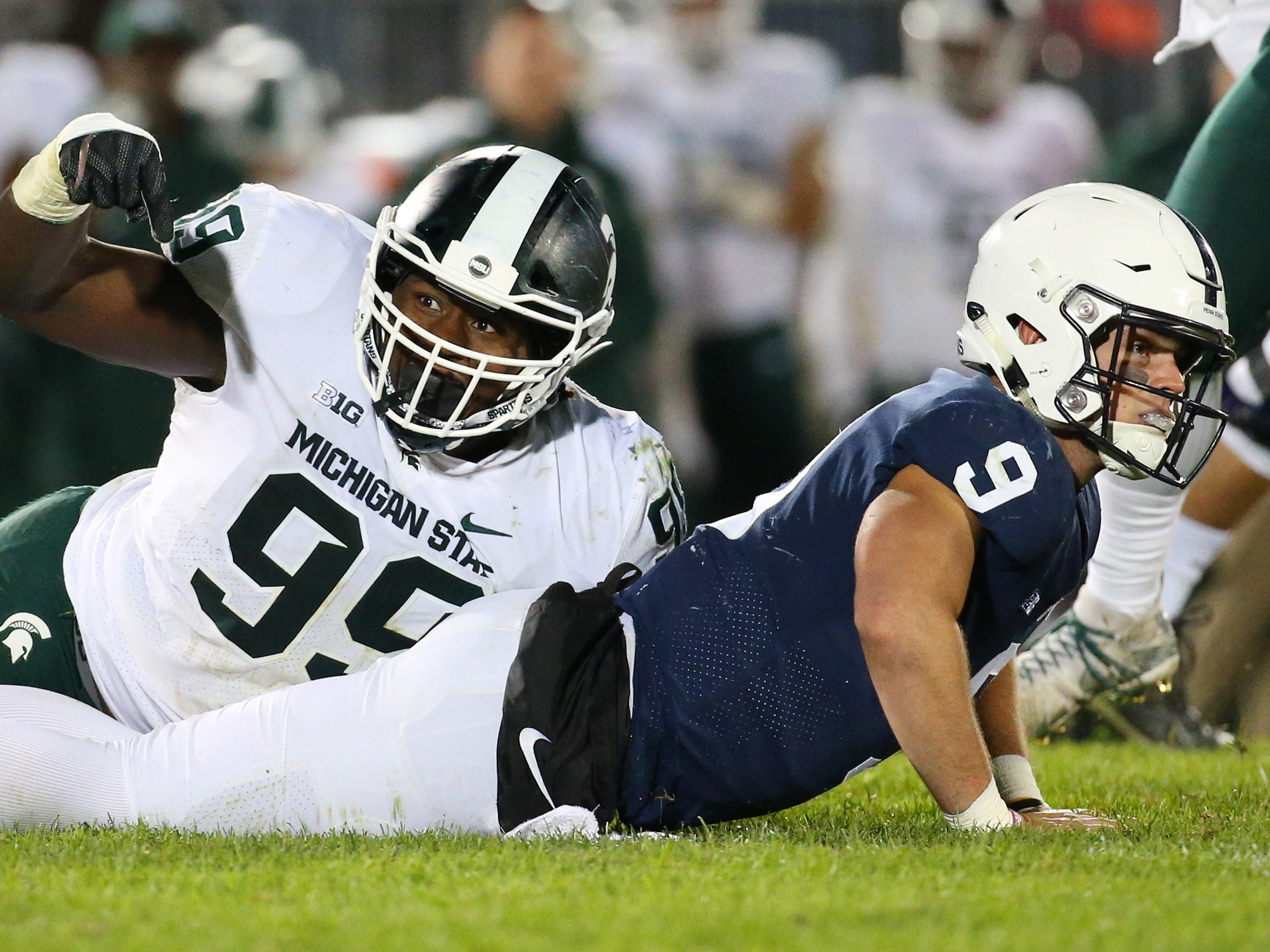 Michigan State defensive tackle Raequan Williams gestures to an official after pressuring Penn State quarterback Trace McSorley during the fourth quarter at Beaver Stadium, Oct. 13, 2018.