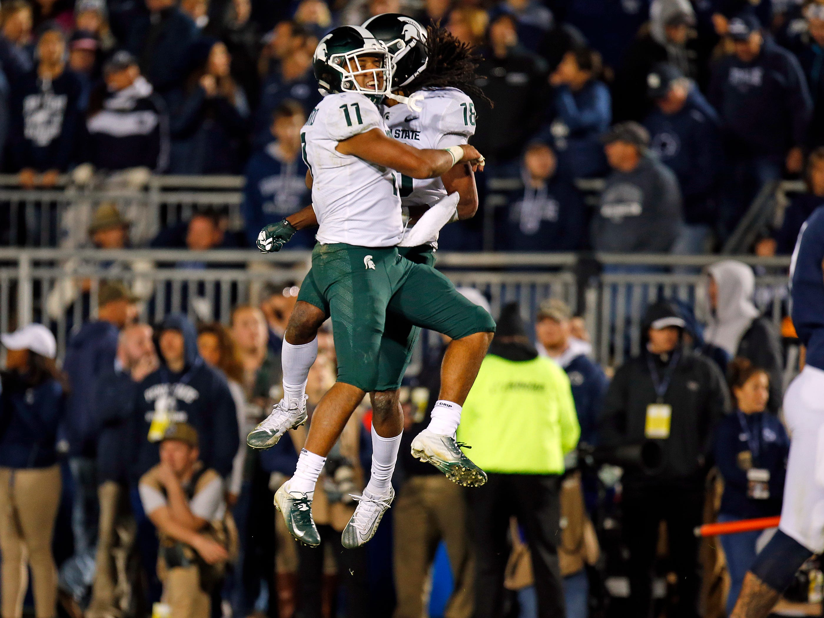 Felton Davis III #18 of the Michigan State Spartans celebrates with Connor Heyward #11 of the Michigan State Spartans after catching a 25 yard touchdown pass in the fourth quarter against the Penn State Nittany Lions on October 13, 2018 at Beaver Stadium in State College, Pennsylvania.