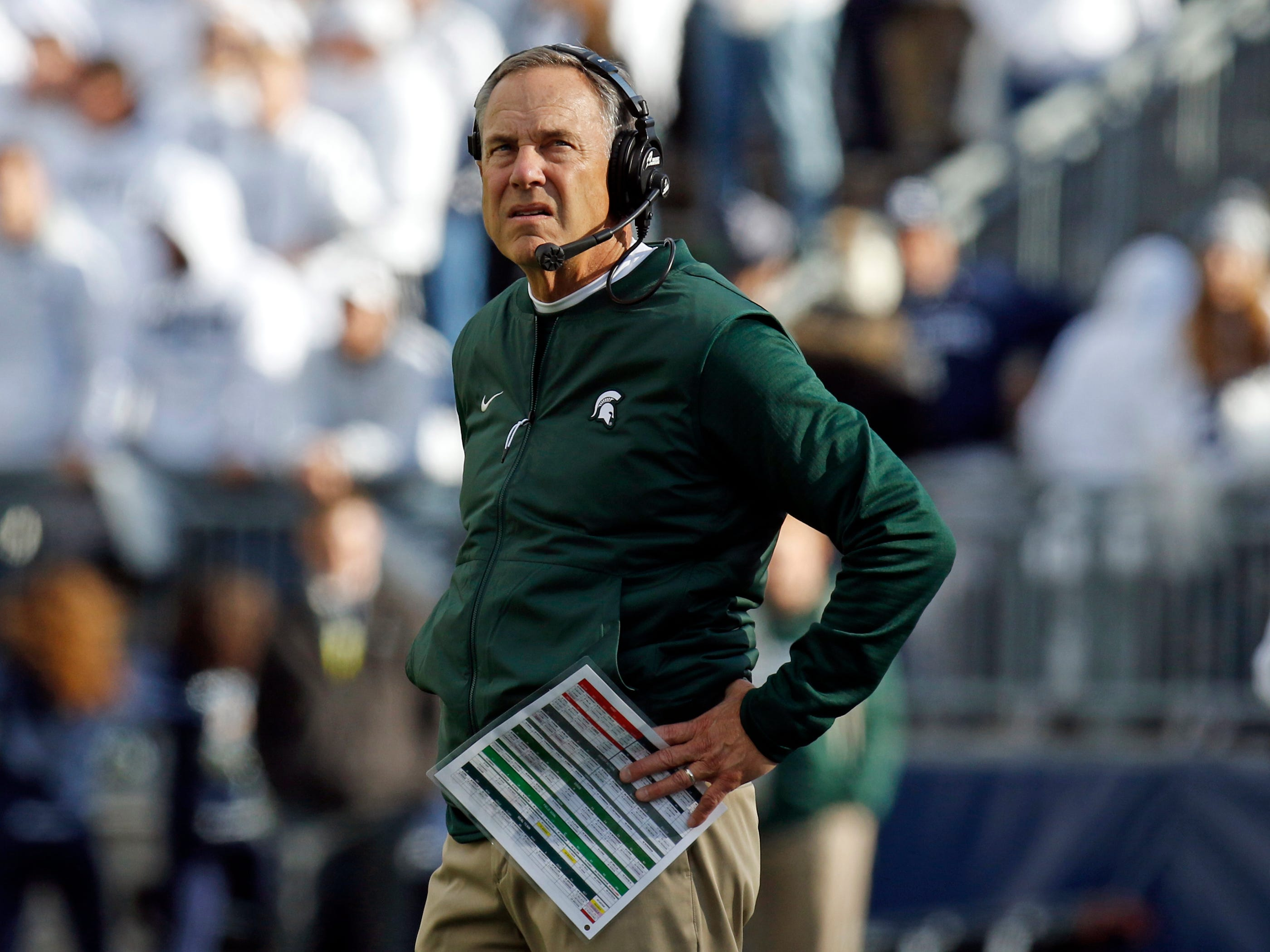 Head coach Mark Dantonio of the Michigan State Spartans looks on against the Penn State Nittany Lions on October 13, 2018 at Beaver Stadium in State College, Pennsylvania.