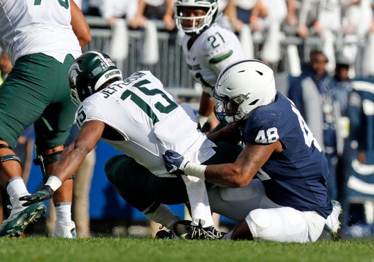 Shareef Miller #48 of the Penn State Nittany Lions tackles La'Darius Jefferson #15 of the Michigan State Spartans on October 13, 2018 at Beaver Stadium in State College, Pennsylvania.
