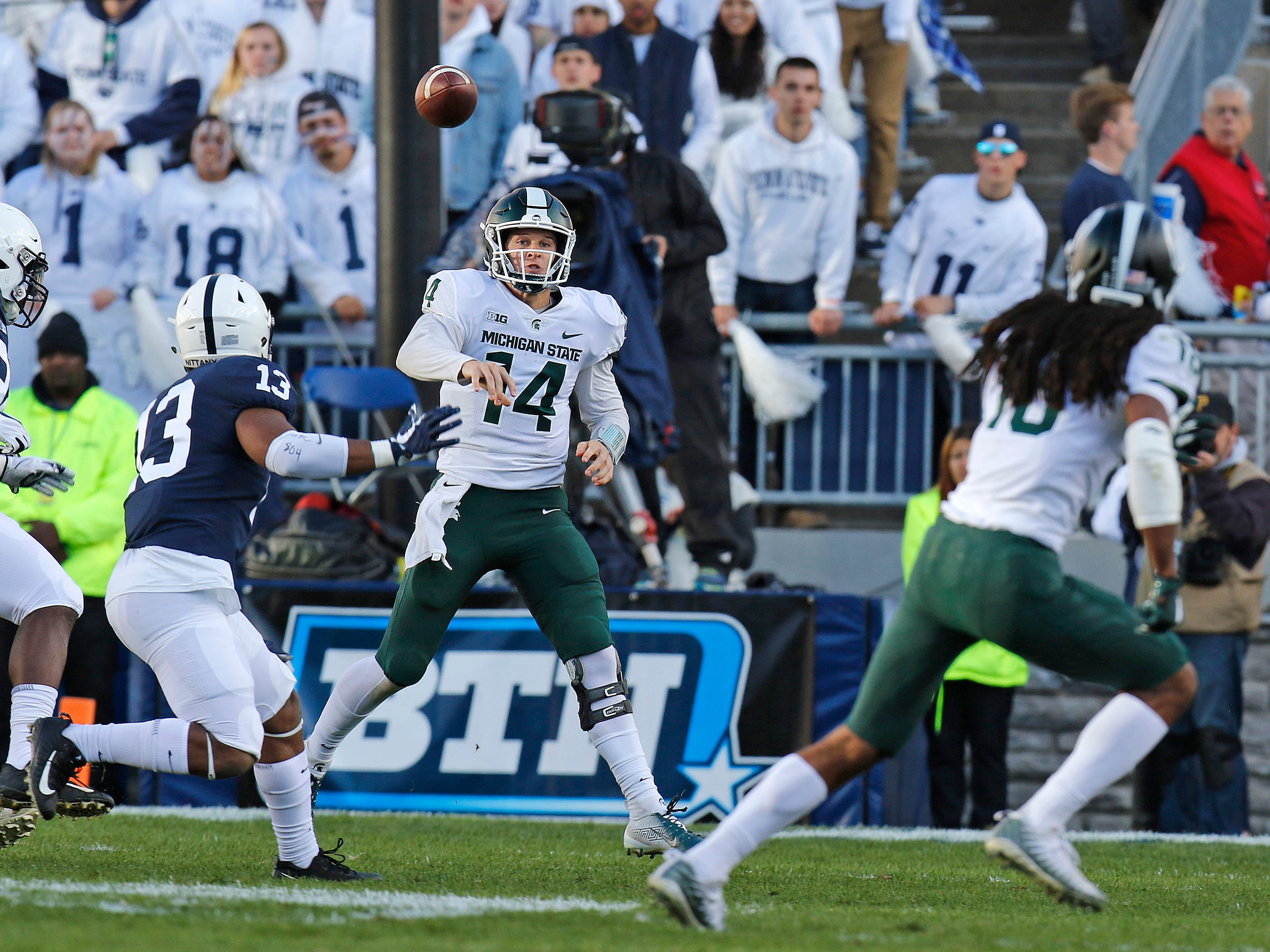 Brian Lewerke #14 of the Michigan State Spartans passes against the Penn State Nittany Lions on October 13, 2018 at Beaver Stadium in State College, Pennsylvania.