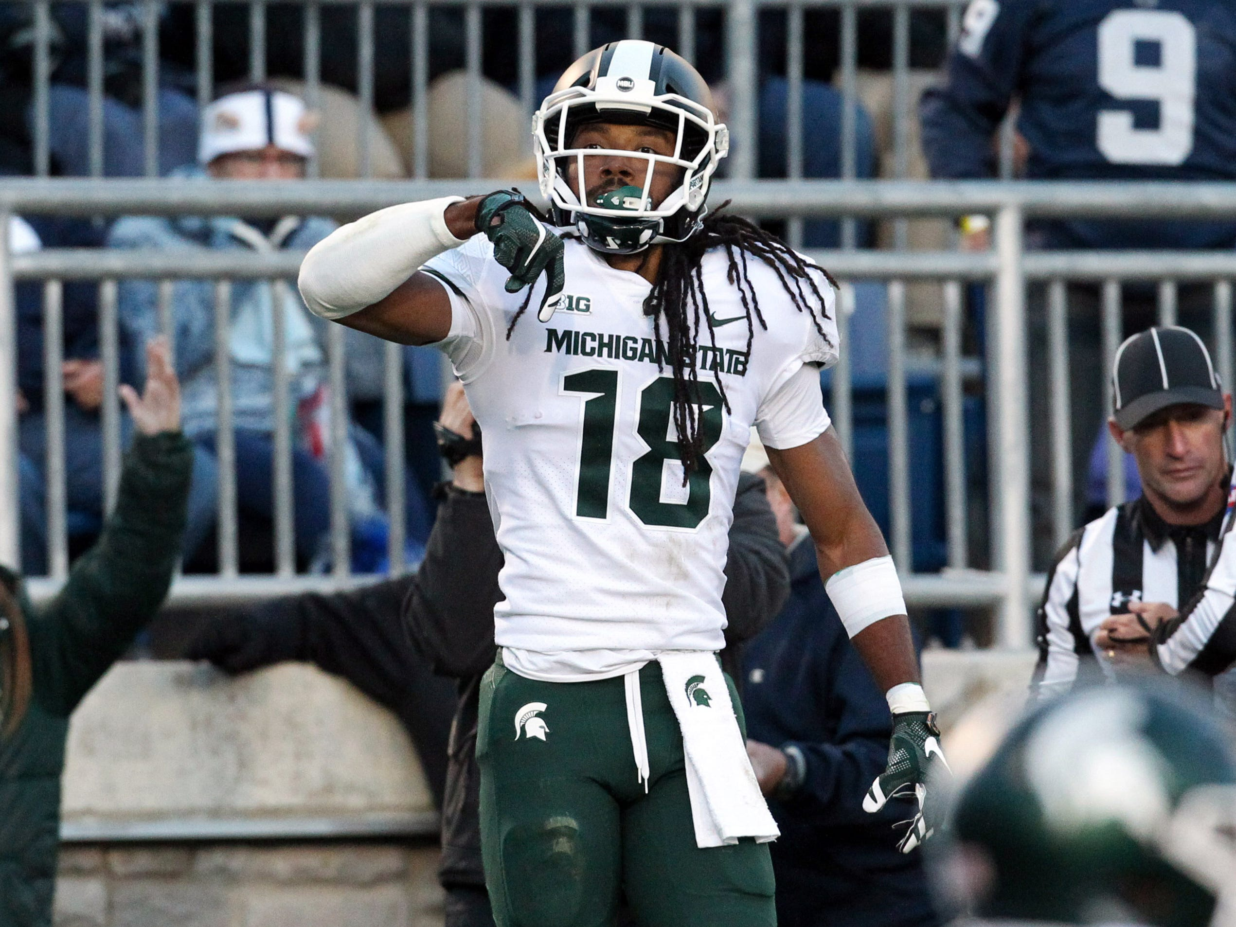 Michigan State Spartans wide receiver Felton Davis III (18) reacts after scoring a touchdown during the third quarter against the Penn State Nittany Lions at Beaver Stadium. Michigan State defeated Penn State 21-17.