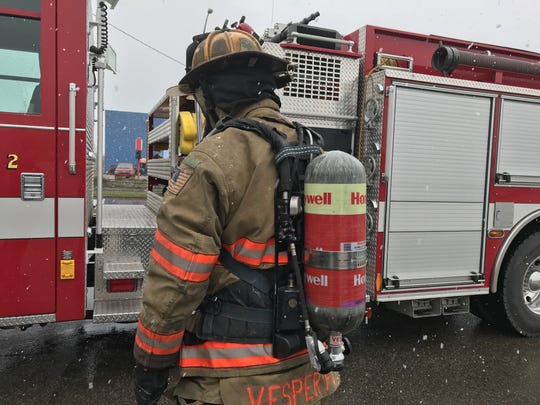 Dustin Brehm of the Vesper Fire Department shows the new self-contained breathing apparatus made possible with a $656,429 grant from the Federal Emergency Management Agency.