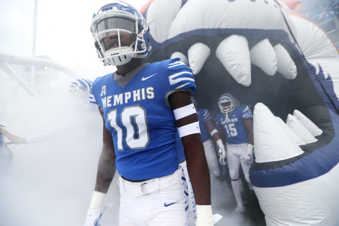 Memphis wide receiver Damonte Coxie runs out on to the field before their game against UCF at the Liberty Bowl in Memphis, Tenn., Saturday, October 13, 2018.